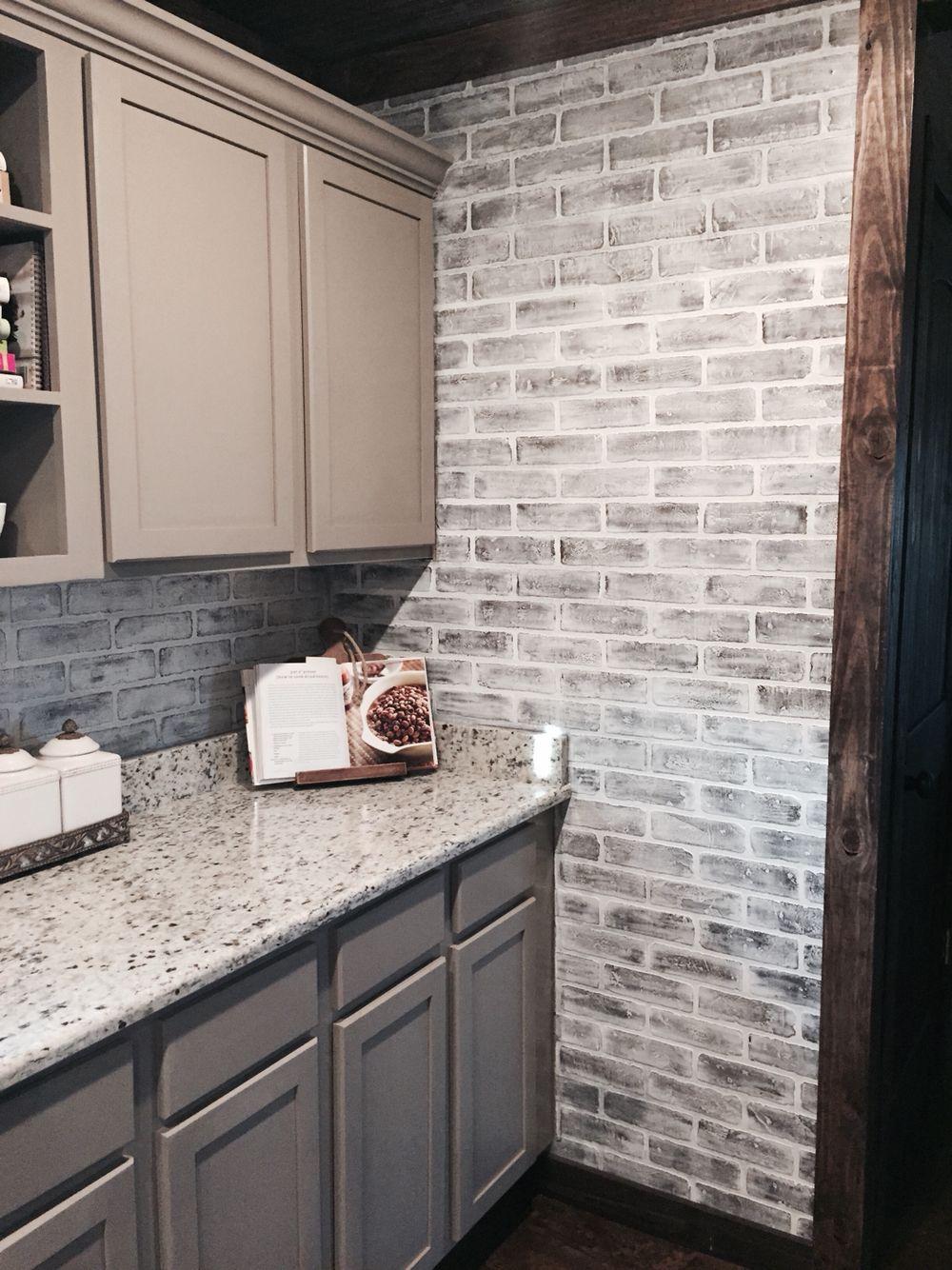 Lowes brick panels painted white. Brick backsplash. Paint