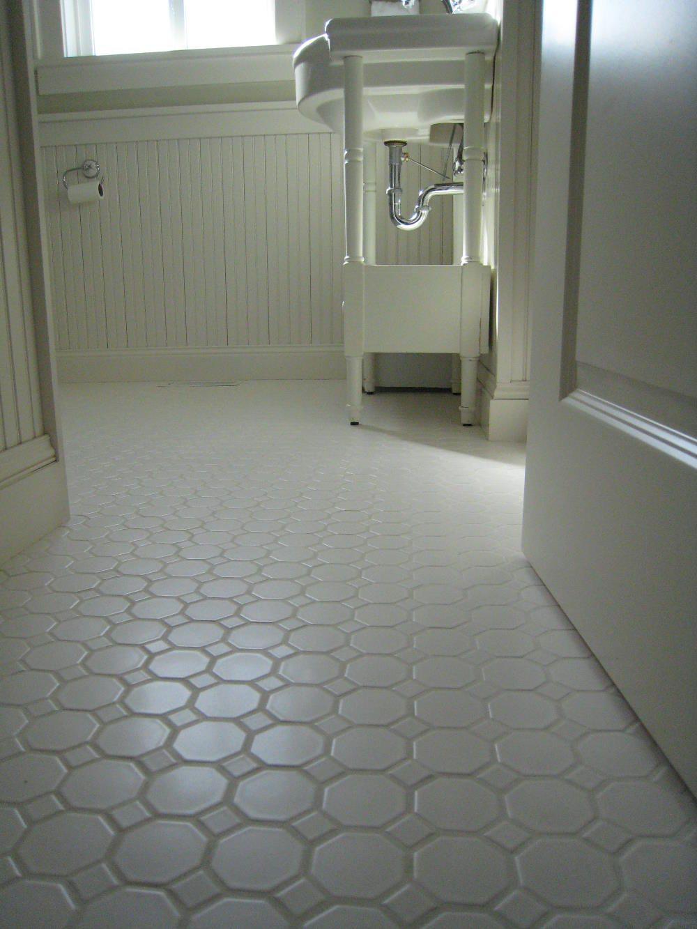 White porcelian, hexagon floor tile shown installed. The