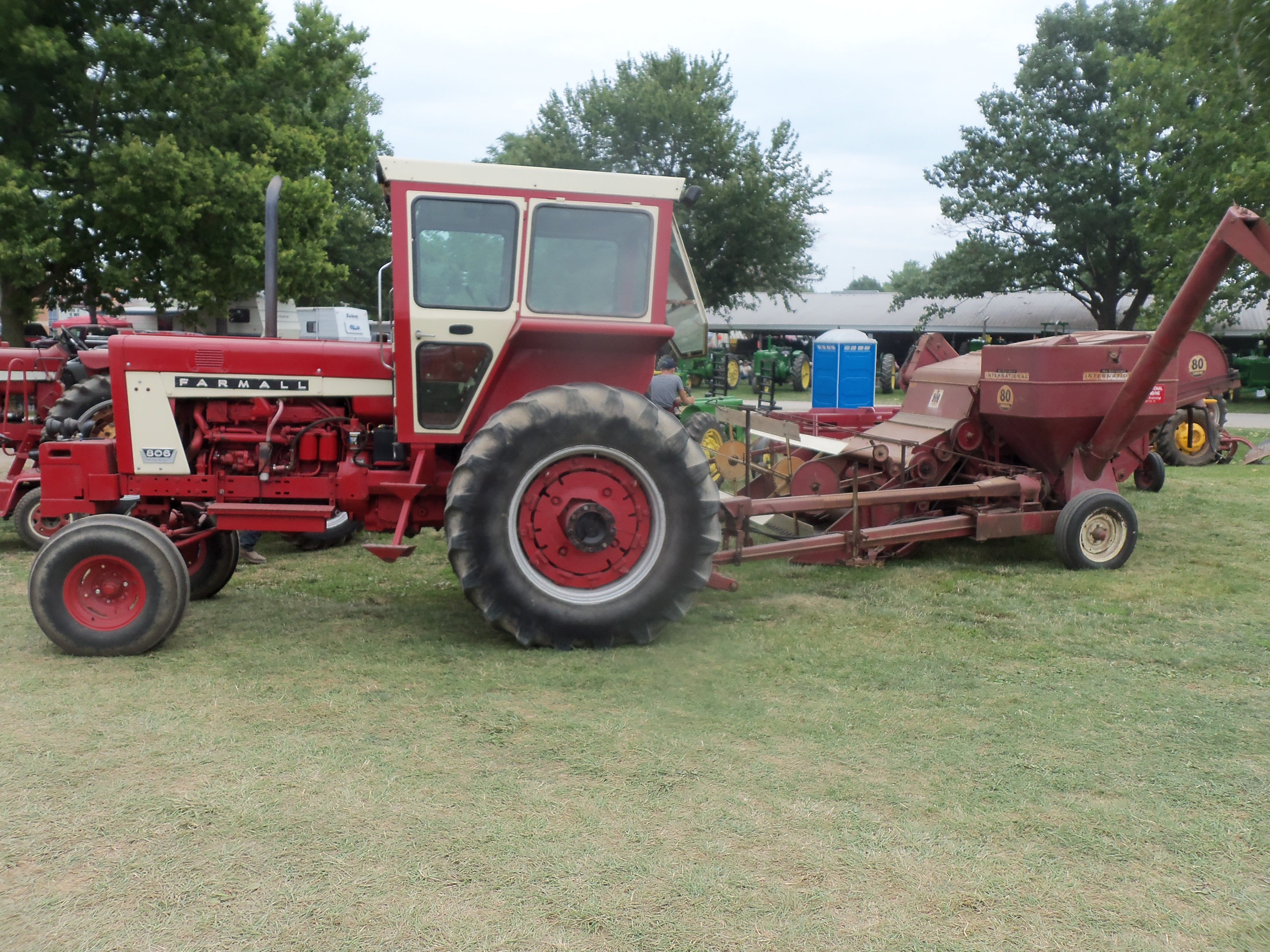 Farmall 806 Hooked To 80 Pull Type Combine