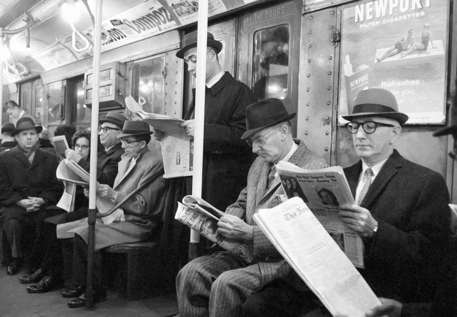 Image result for reading the newspaper on train 1930 nyc