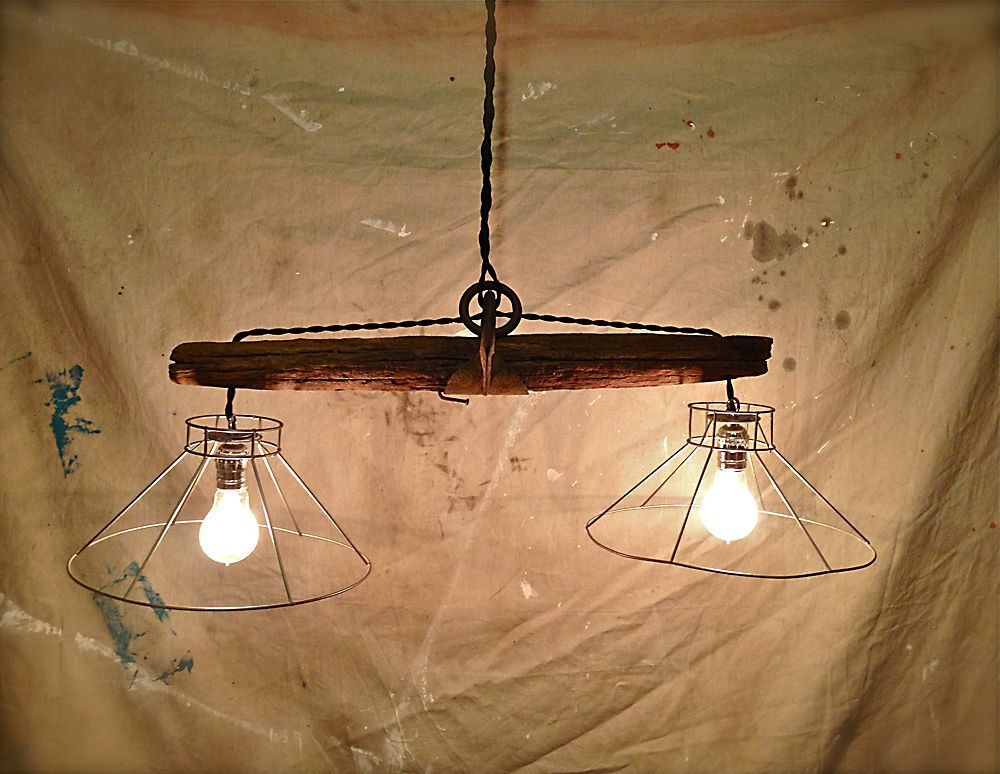 Rustic hanging light fixture made from and old plowing
