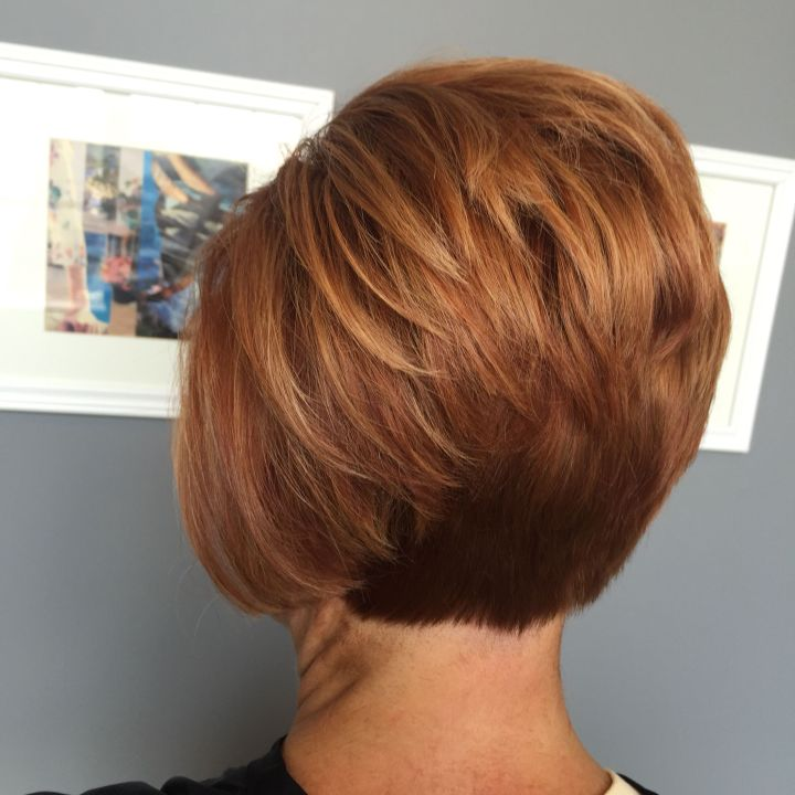 Short red stacked bob …