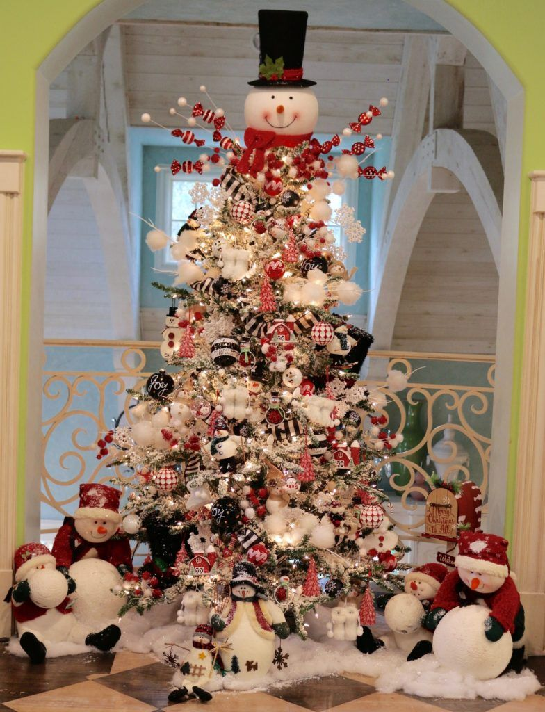 Here is the snowman tree in our family game room! Check