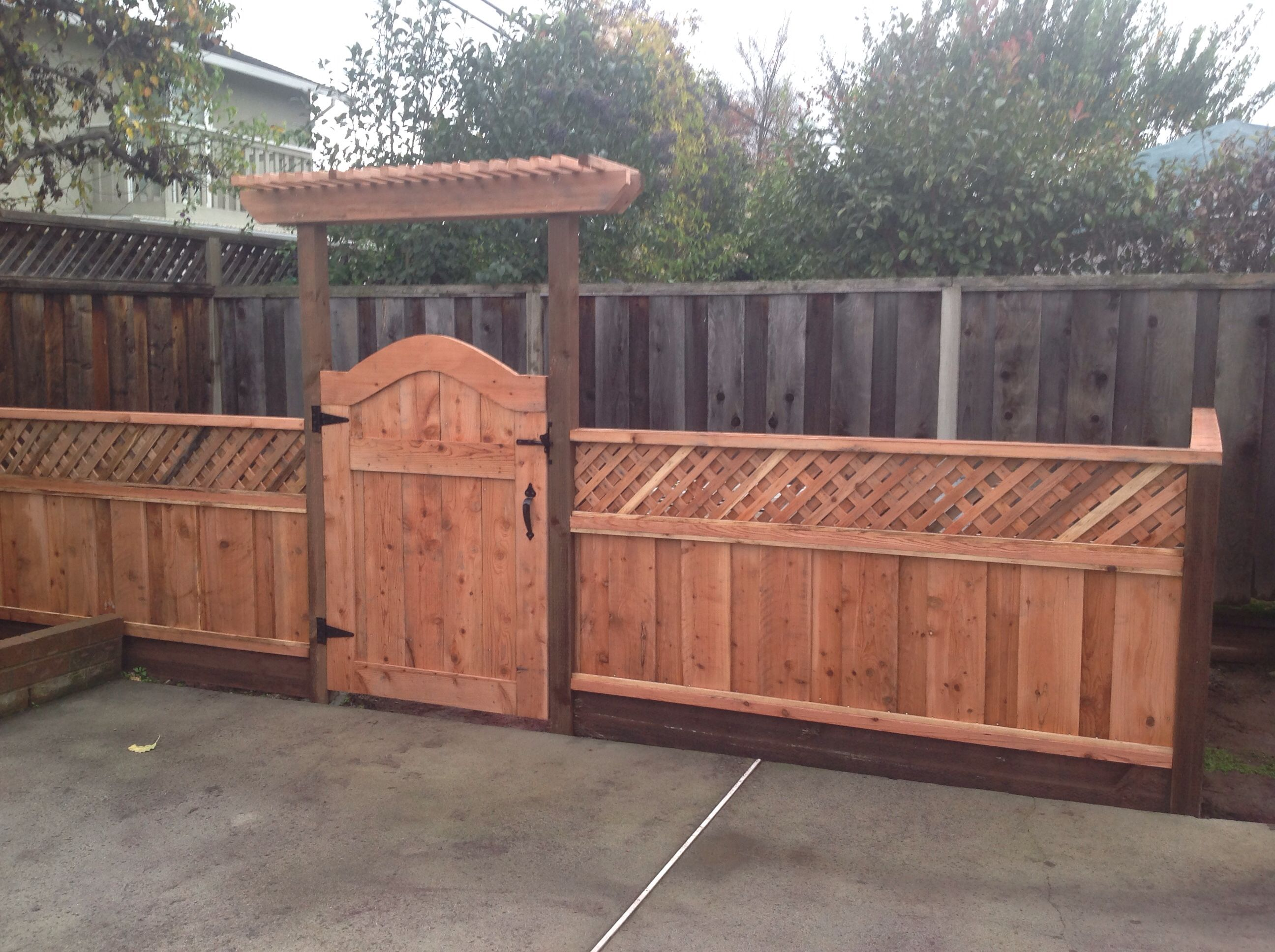 After Pool equipment fence with gate and small arbor