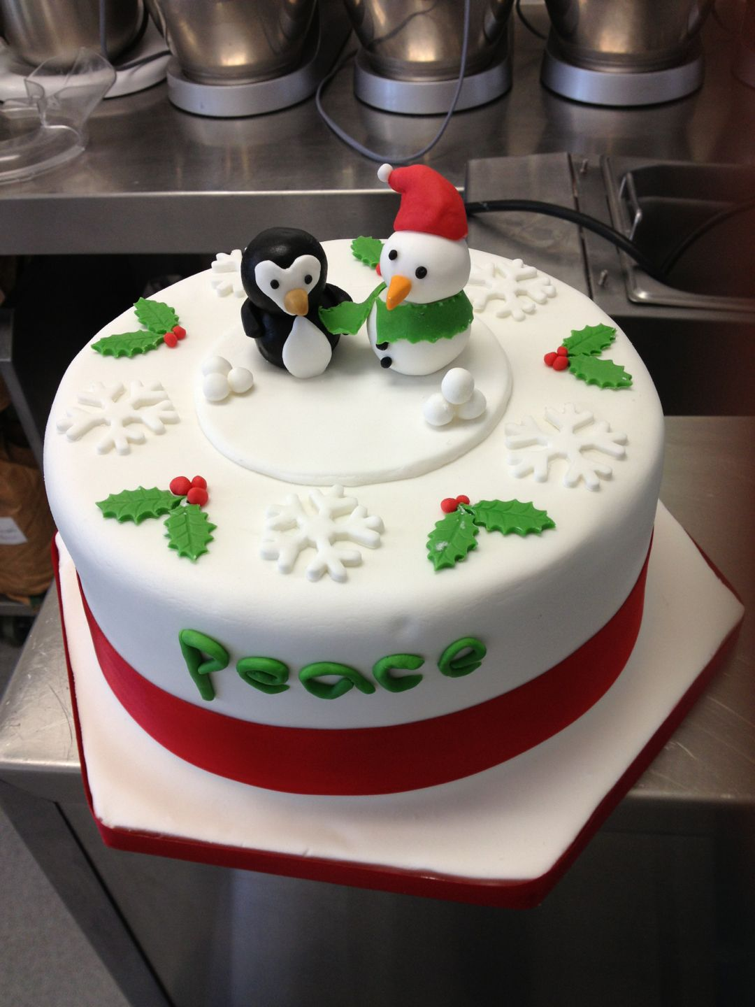 Round Christmas cake with penguin & snowman toppers and