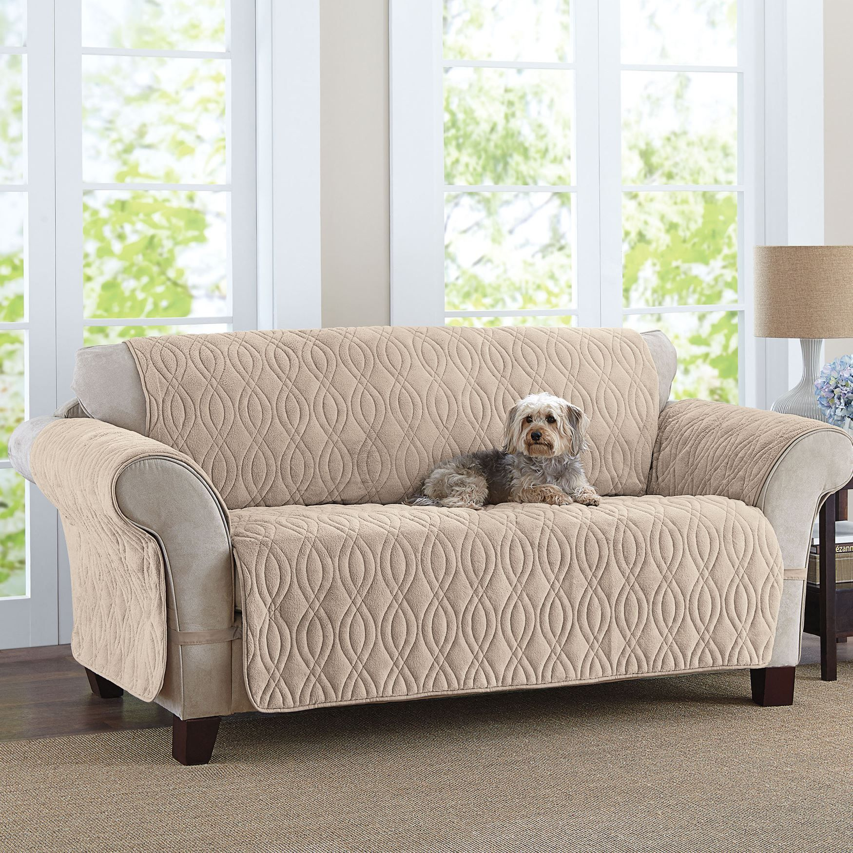 This deluxe quilted, fleecelike sofa cover is designed to