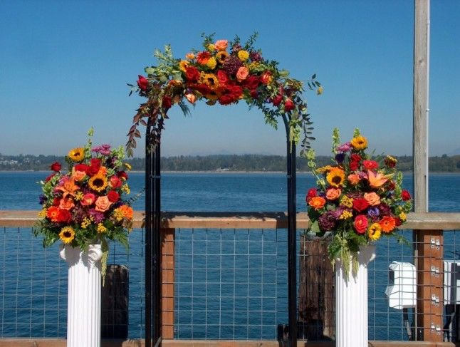 White Trelles Paneling Decorated For A Autum Wedding