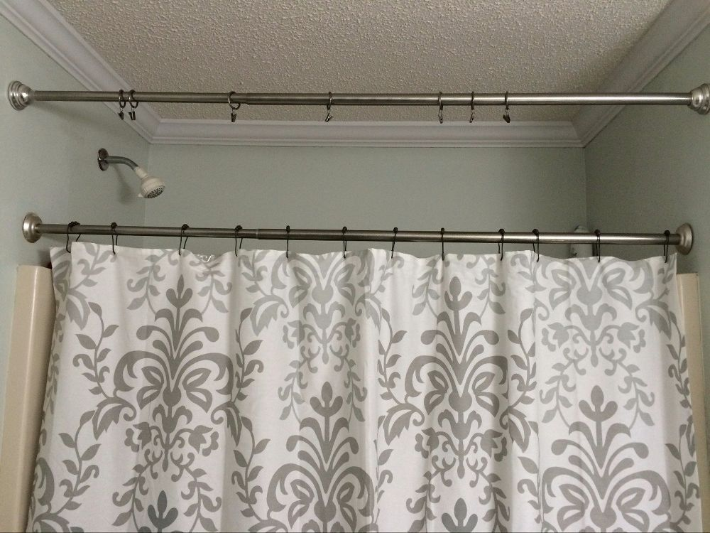 See How To Hang A Second Tension Rod In Your Bathroom To Make Your Shower Curtain Look SO Much