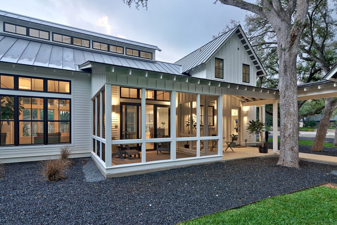 Modern farmhouse screened in porch with standing seam roof