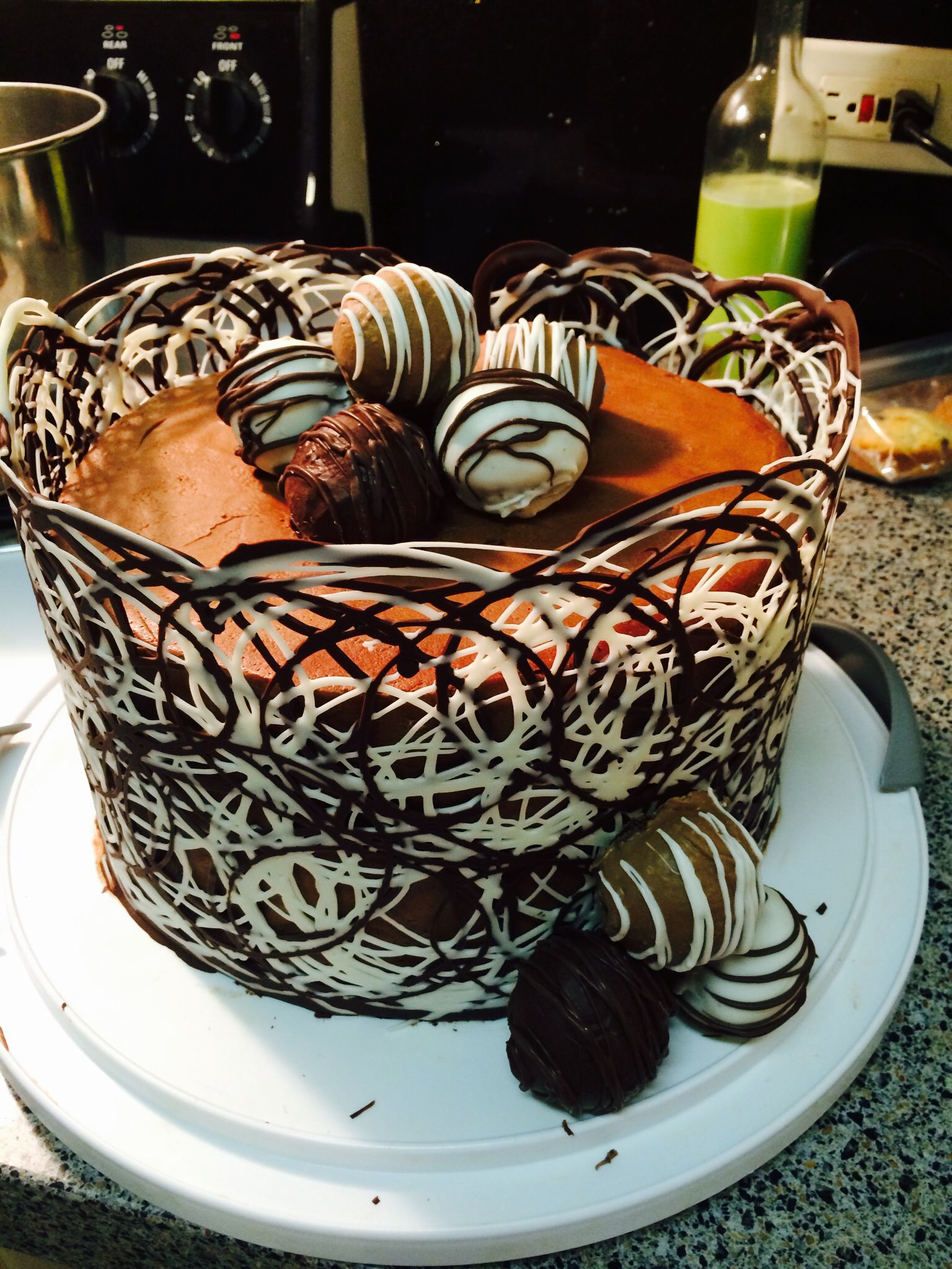 Chocolate Cake Wrapped With A Piped White And Milk