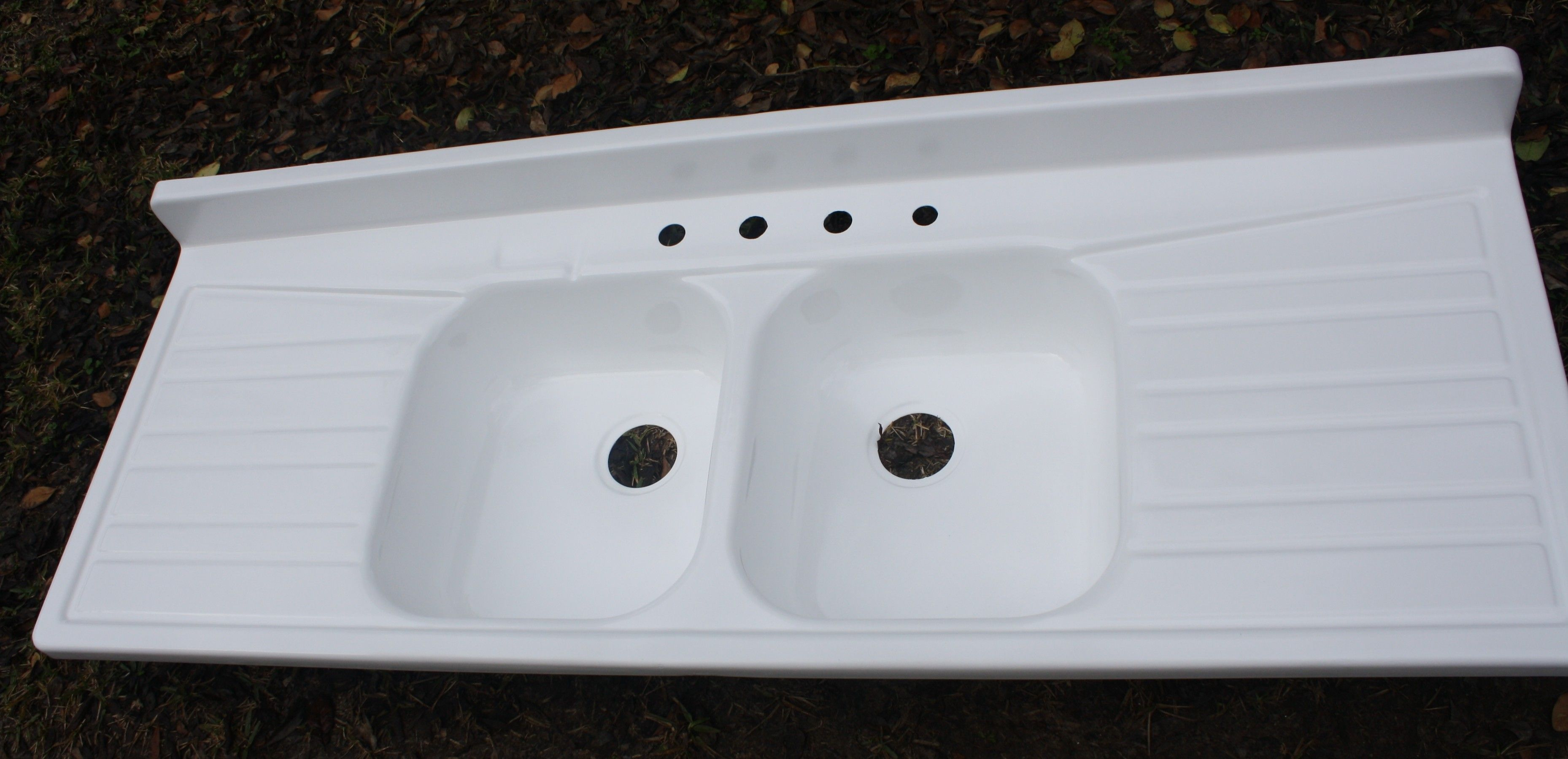large ceramic or enameled sinks with drain board 1950's