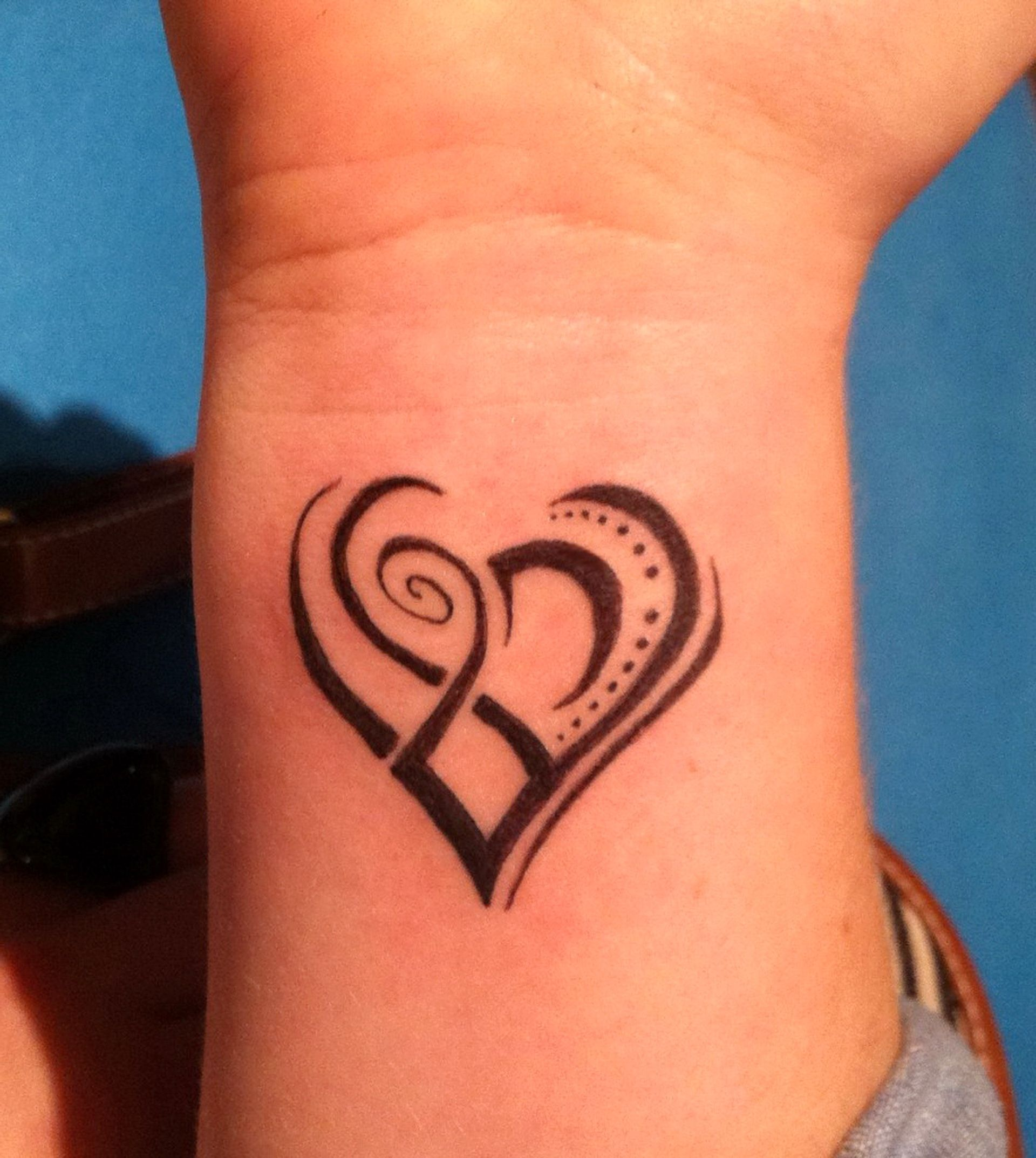 Awesome Tribal Tattoo Art Design Ideas heart tattoo for