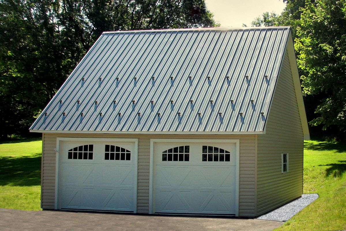 This 12/12 Pitched Roof on a Two Car Garage allows for