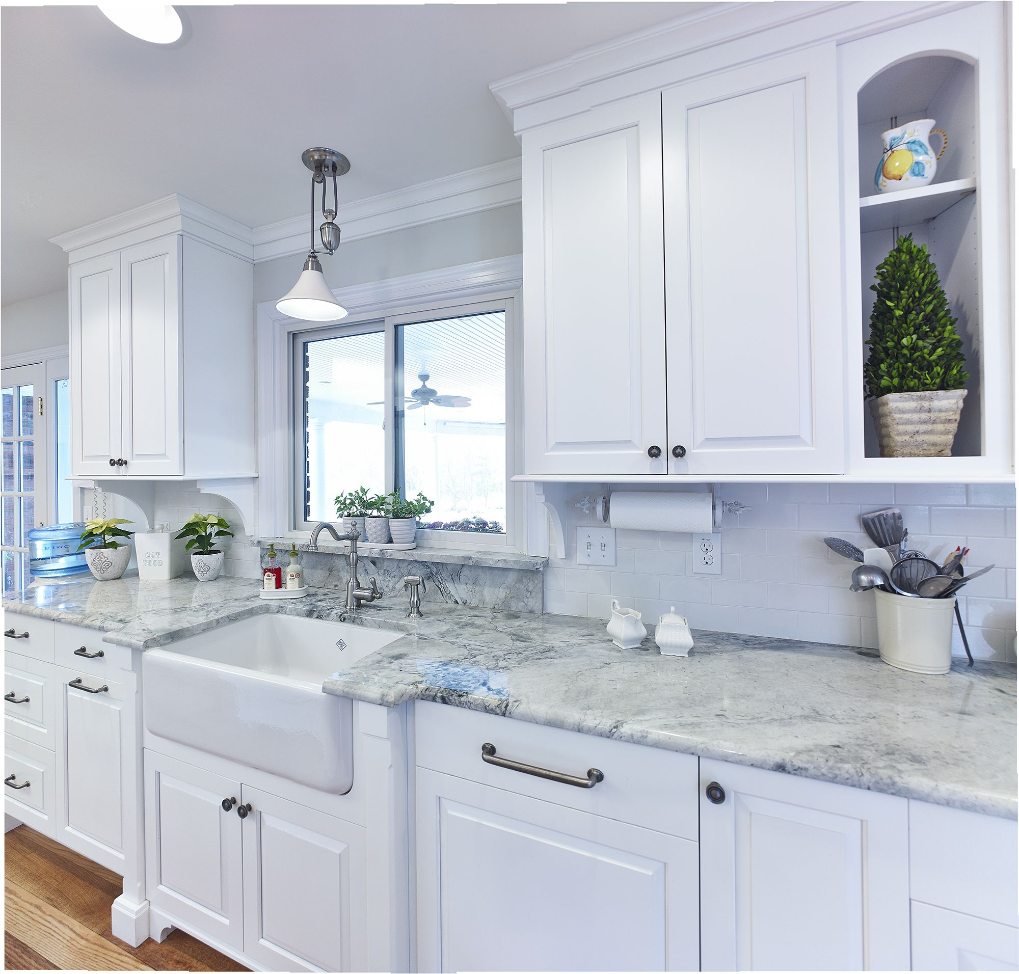 Custom white kitchen with farmhouse sink and super white