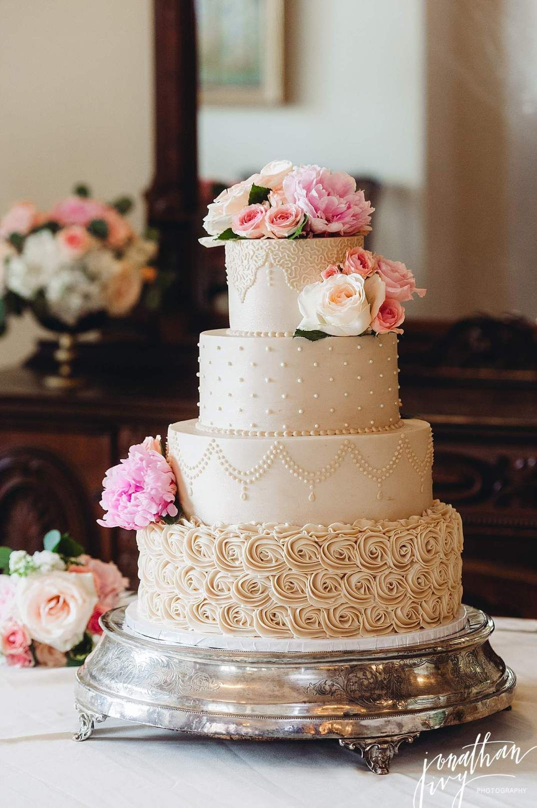Beautiful beige 4 tier buttercream wedding cake