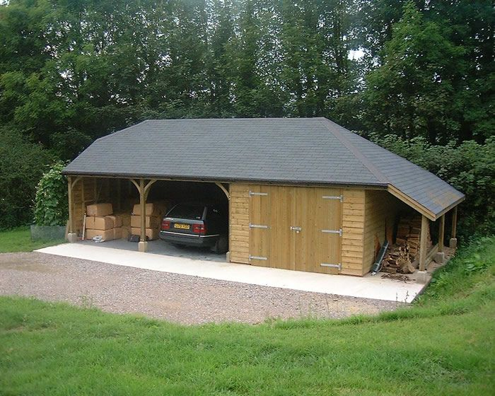 Two open carports, 1 enclosed garage. Bitumen Felt Slate