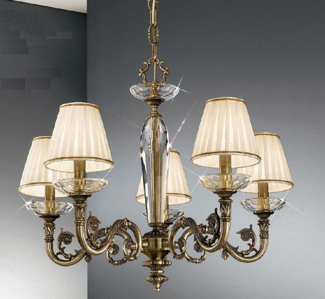 The Kolarz Lighting Contarini 5 Light Chandelier Is In An Antique Brass Finish Dressed With Cream Shades And Crystal Sconces