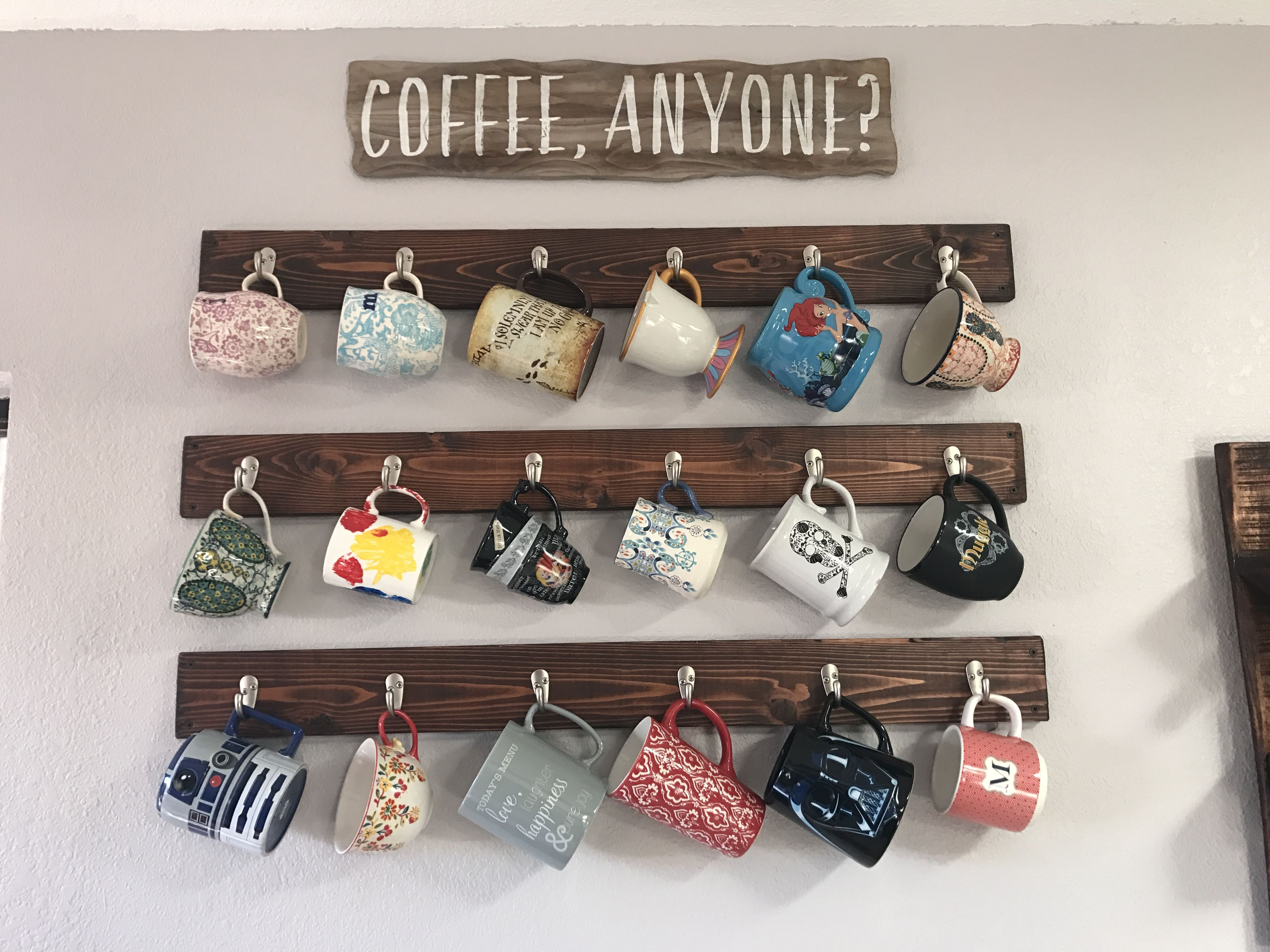 Coffee mug rack. Hanging coffee mugs on the walls. home