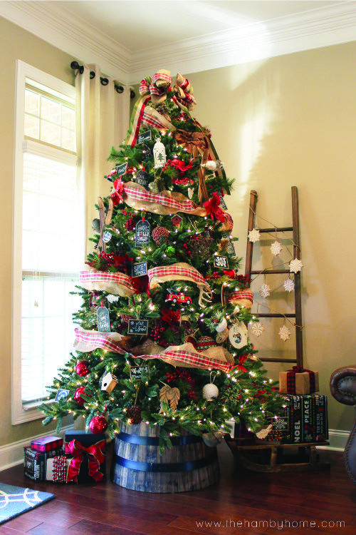 love this Christmas tree in a barrel! Also that ladder