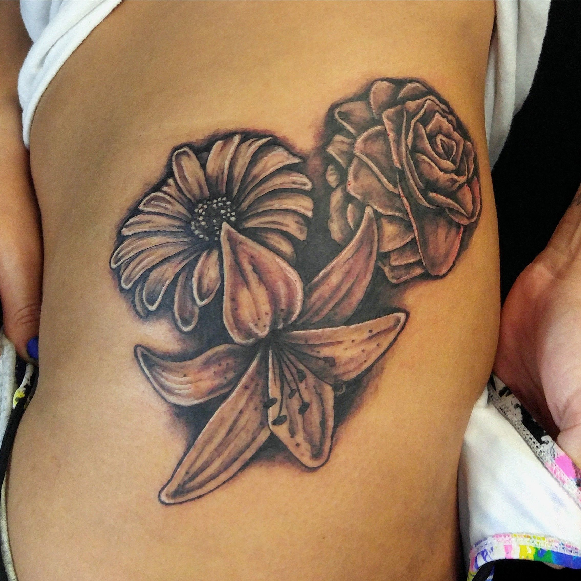 Rose Lily Daisy Tattoo By Mike Hessinger at Moonlight