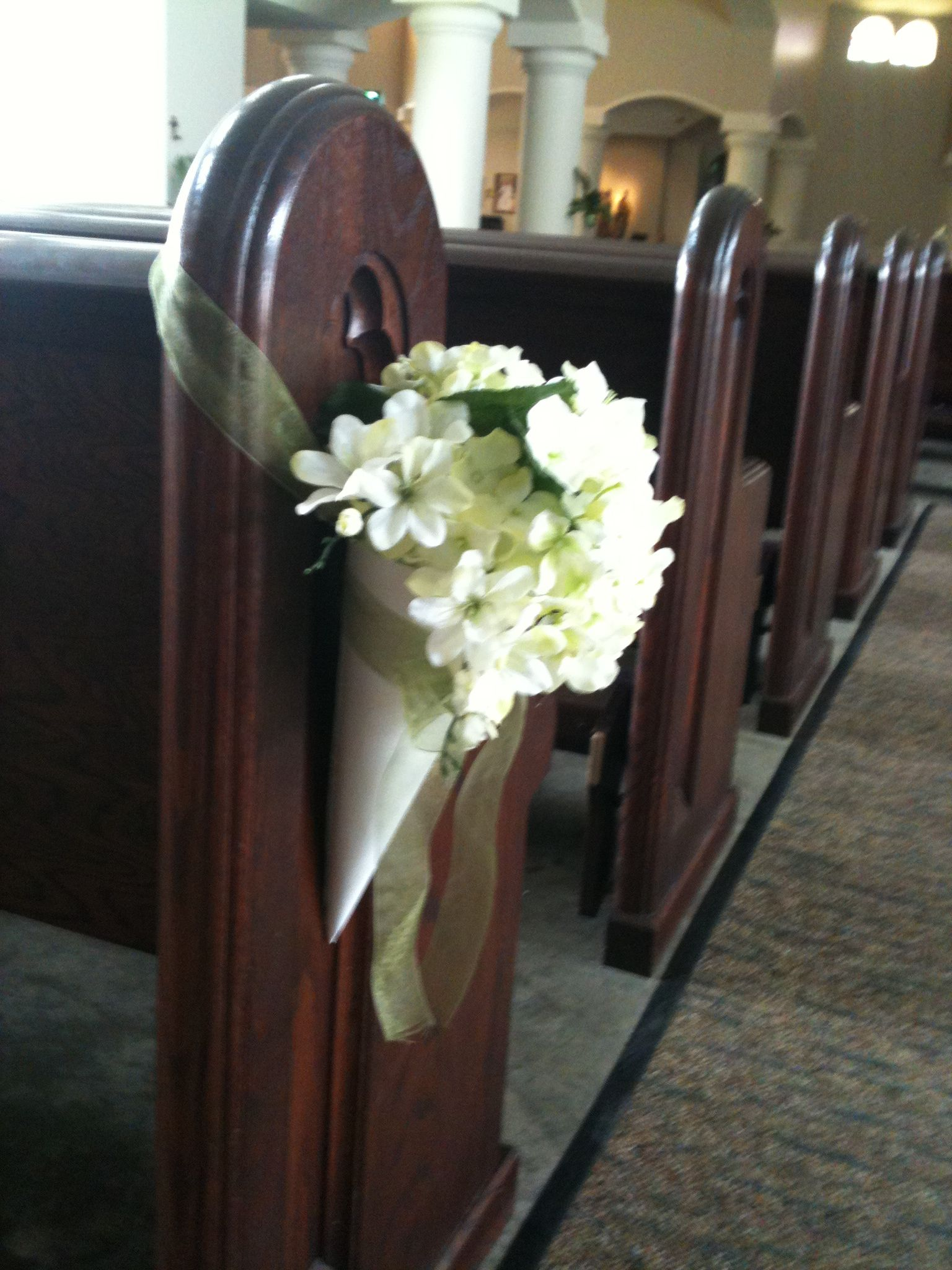 Idea for flower arrangement for church pews Wedding