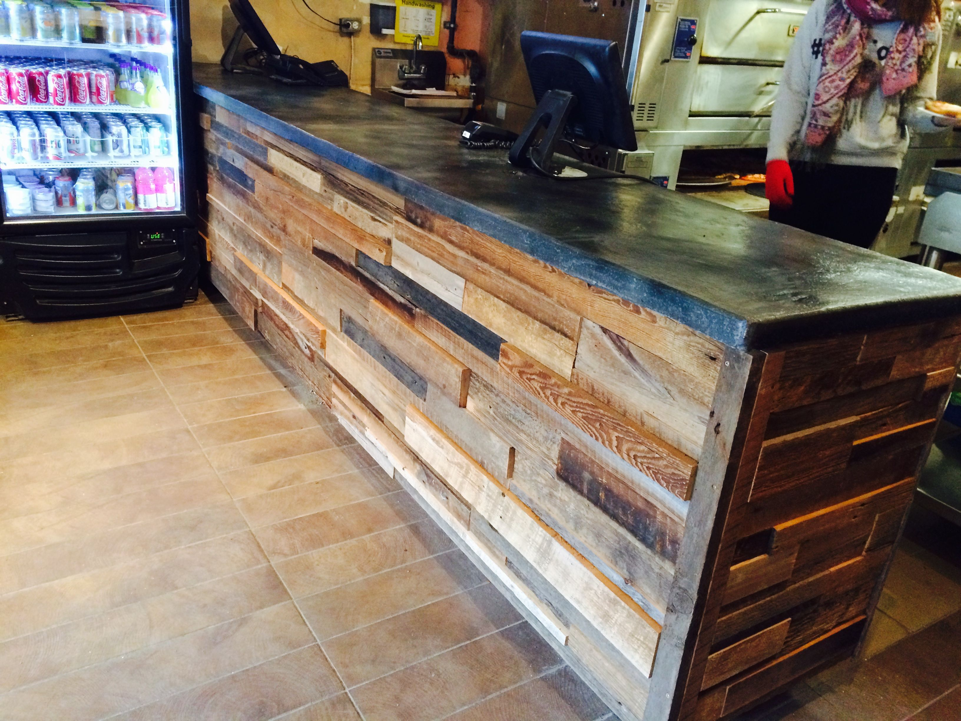 Reclaimed wood counter area for King Slice Pizza in