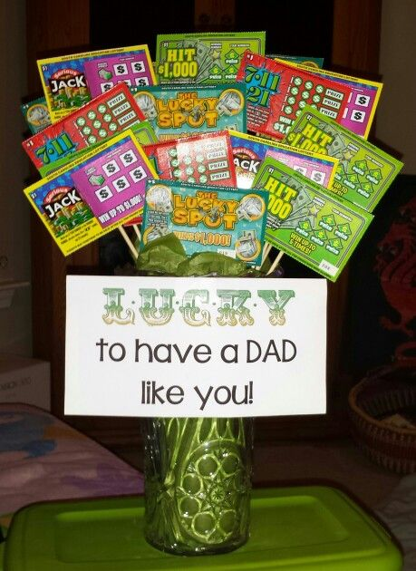 "Show Dad how lucky you are to have him with a lottery ticket bouquet. Pour rice or beans into a vase, attach lottery tickets to bamboo skewers and arrange the ""stems"" in the rice."