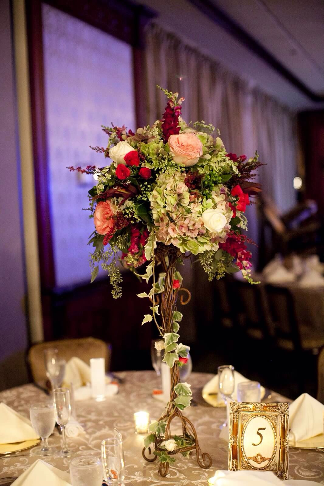 Tall gold stand floral centerpieces by Black Dahlia Inc
