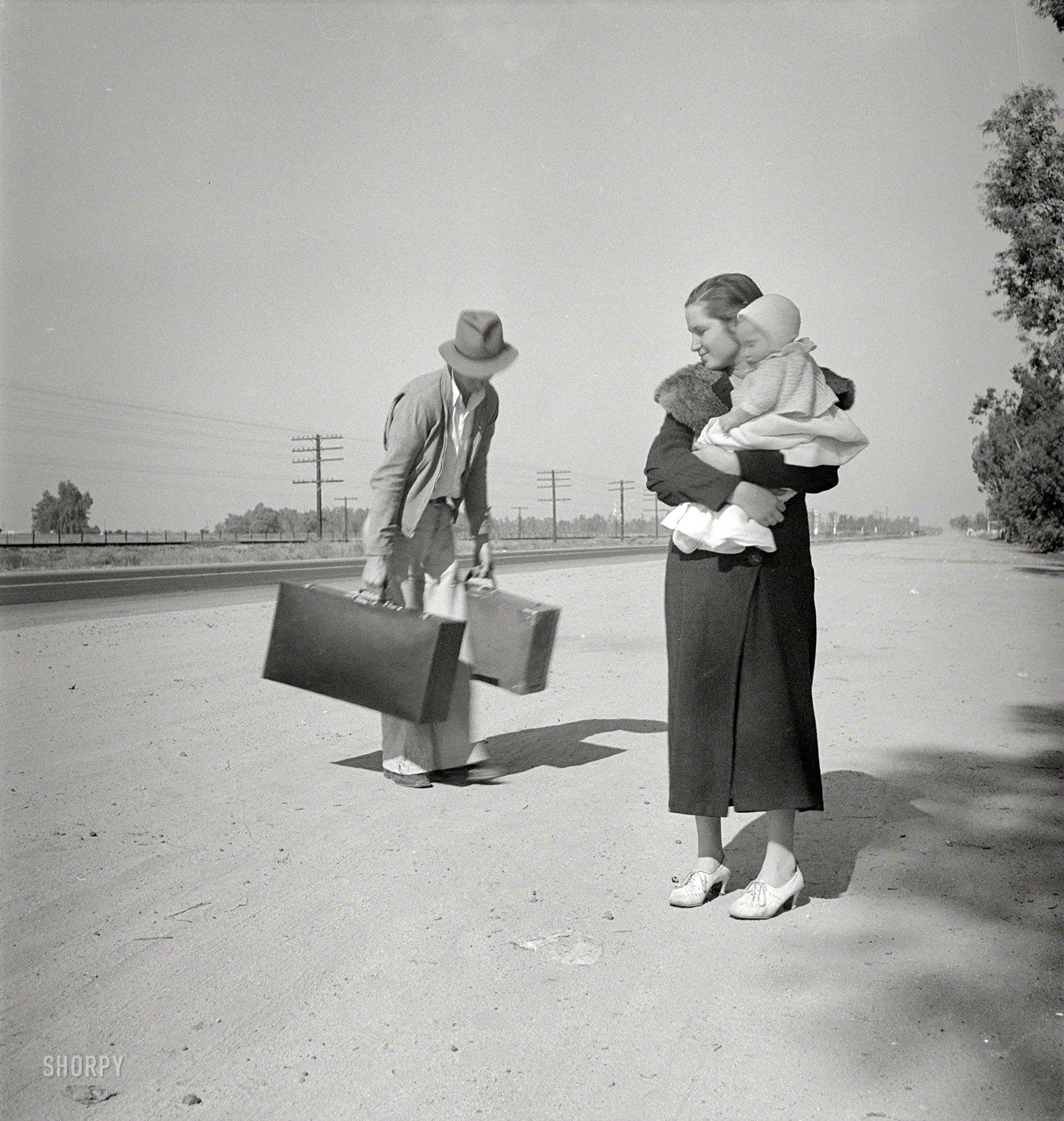 "November 1936. ""Young family, penniless, hitchhiking on U"