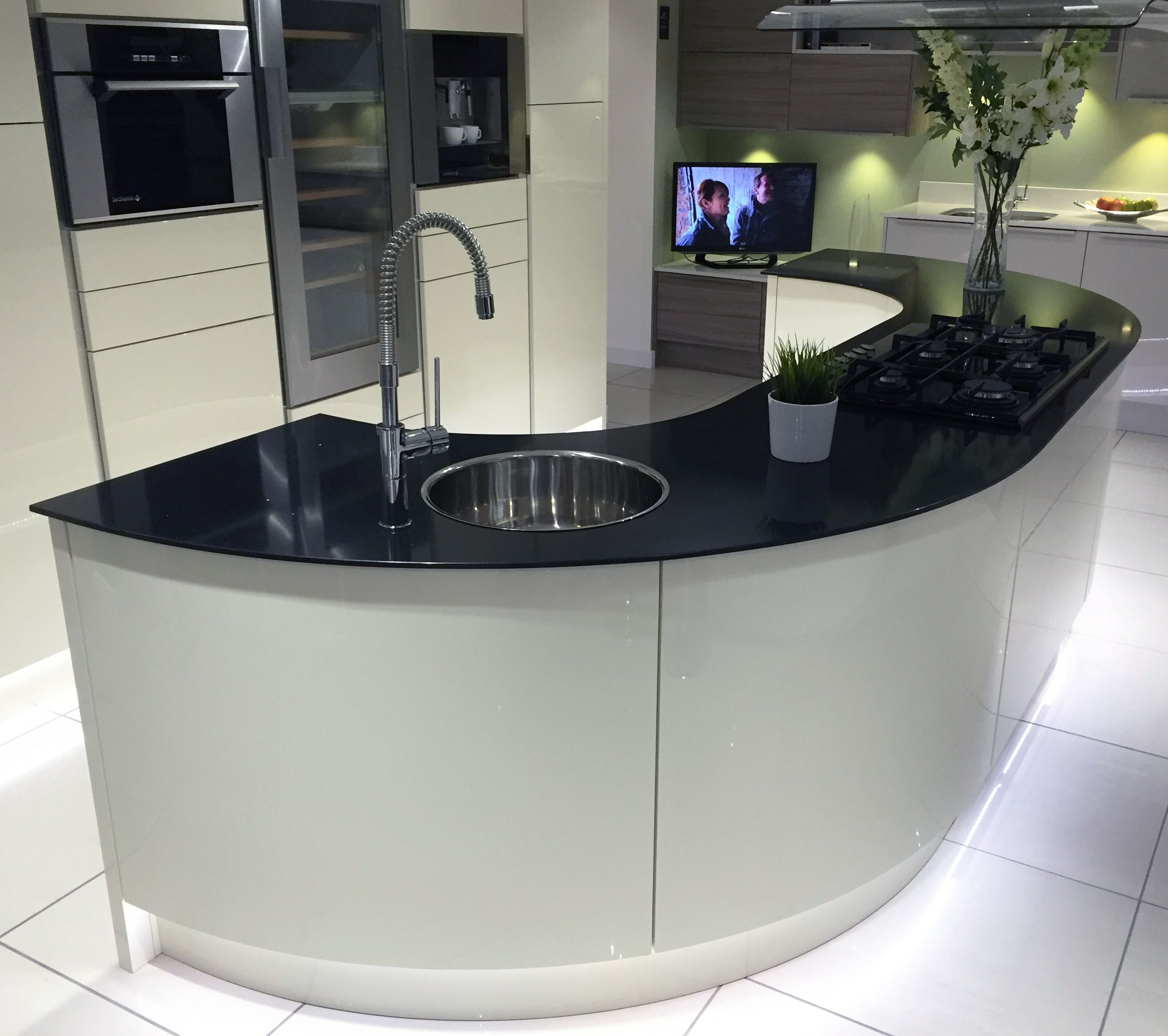 Gloss Ivory kitchen island with large curved units and
