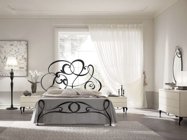 Black-contemporary-wrought-iron-bed-with-headboard-in