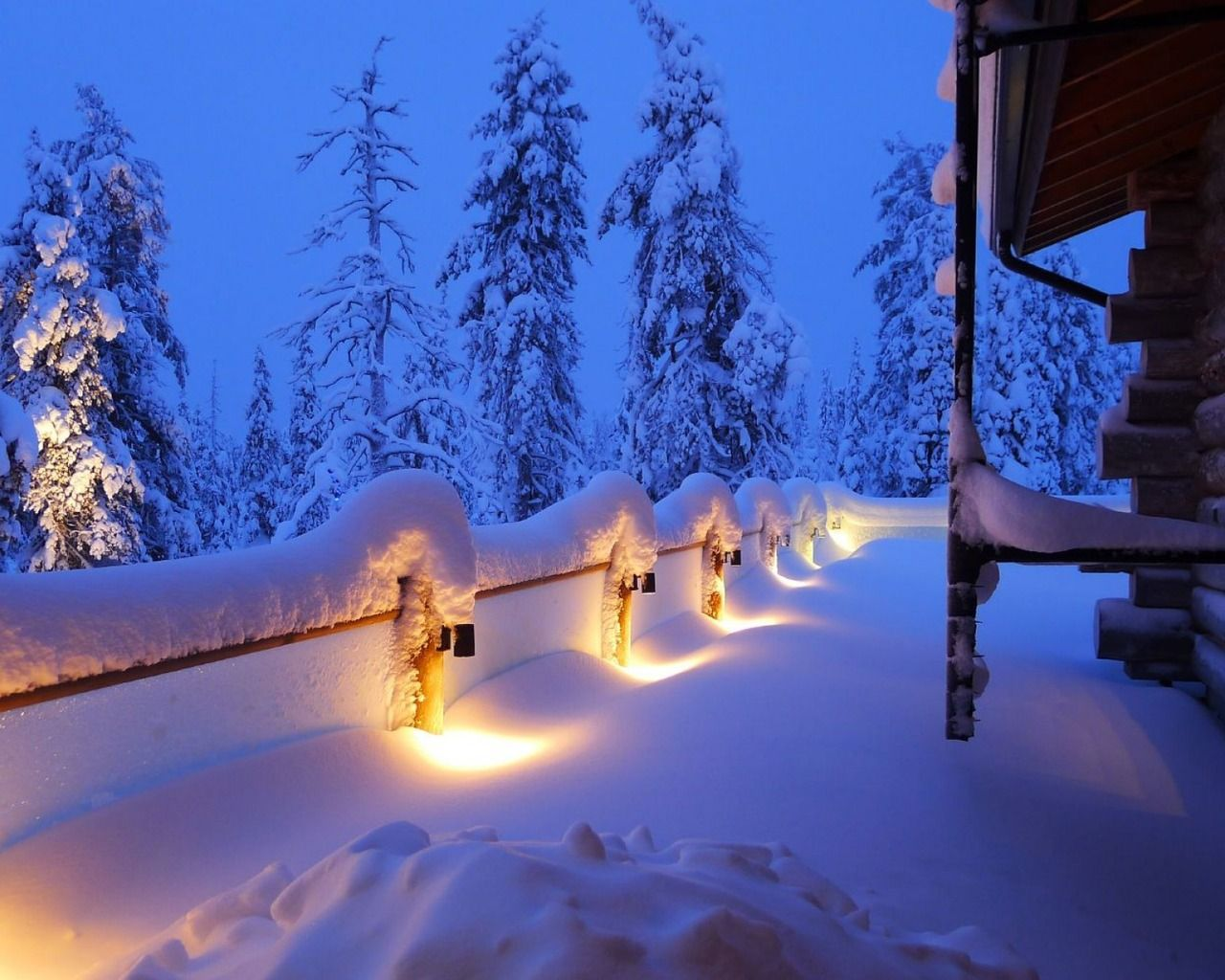 Walkway Lights Glowing Through The Heavy Snow Winter