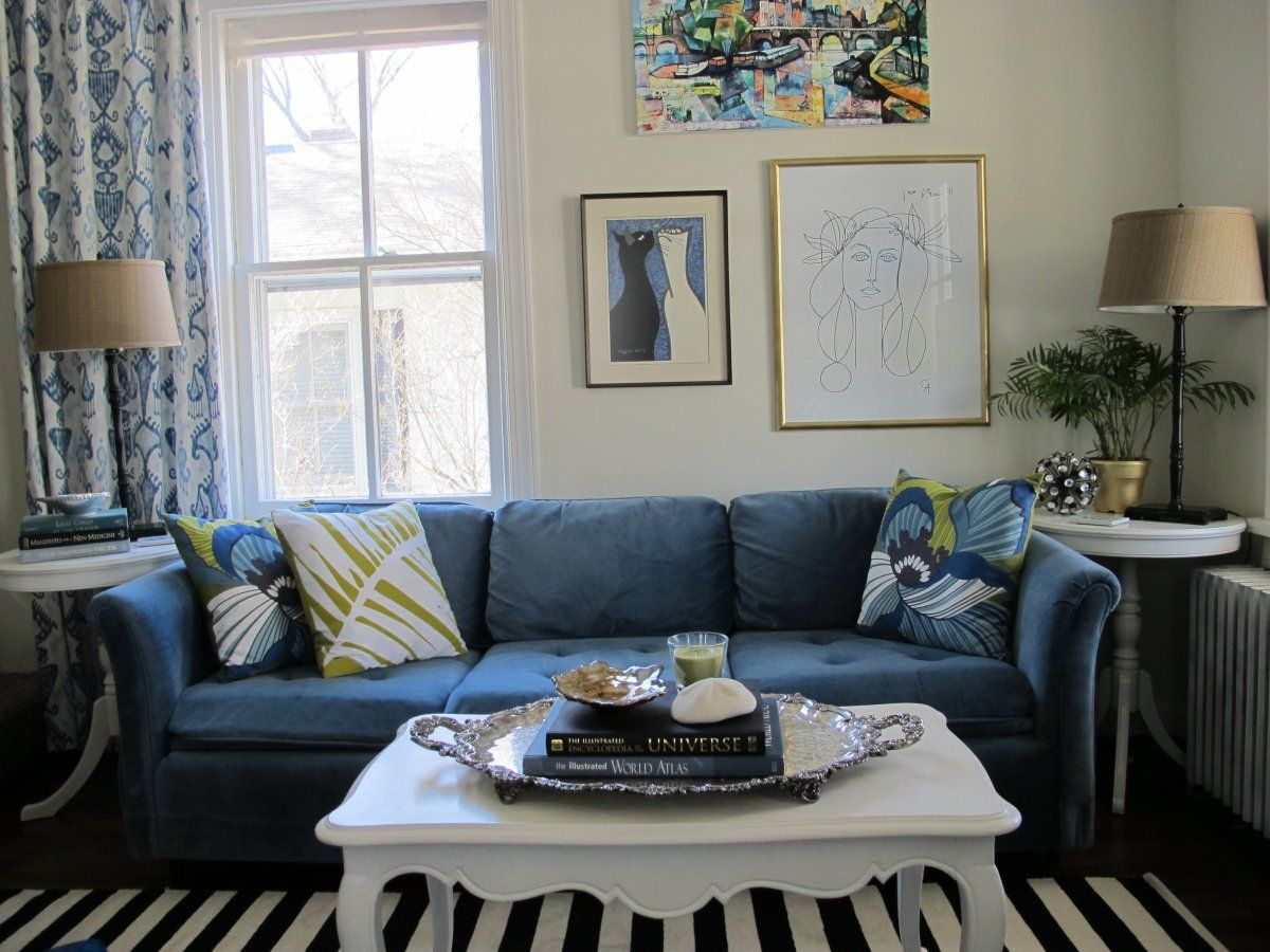 Living Room With Navy Blue Couch And Strip Rug Decor Ideas