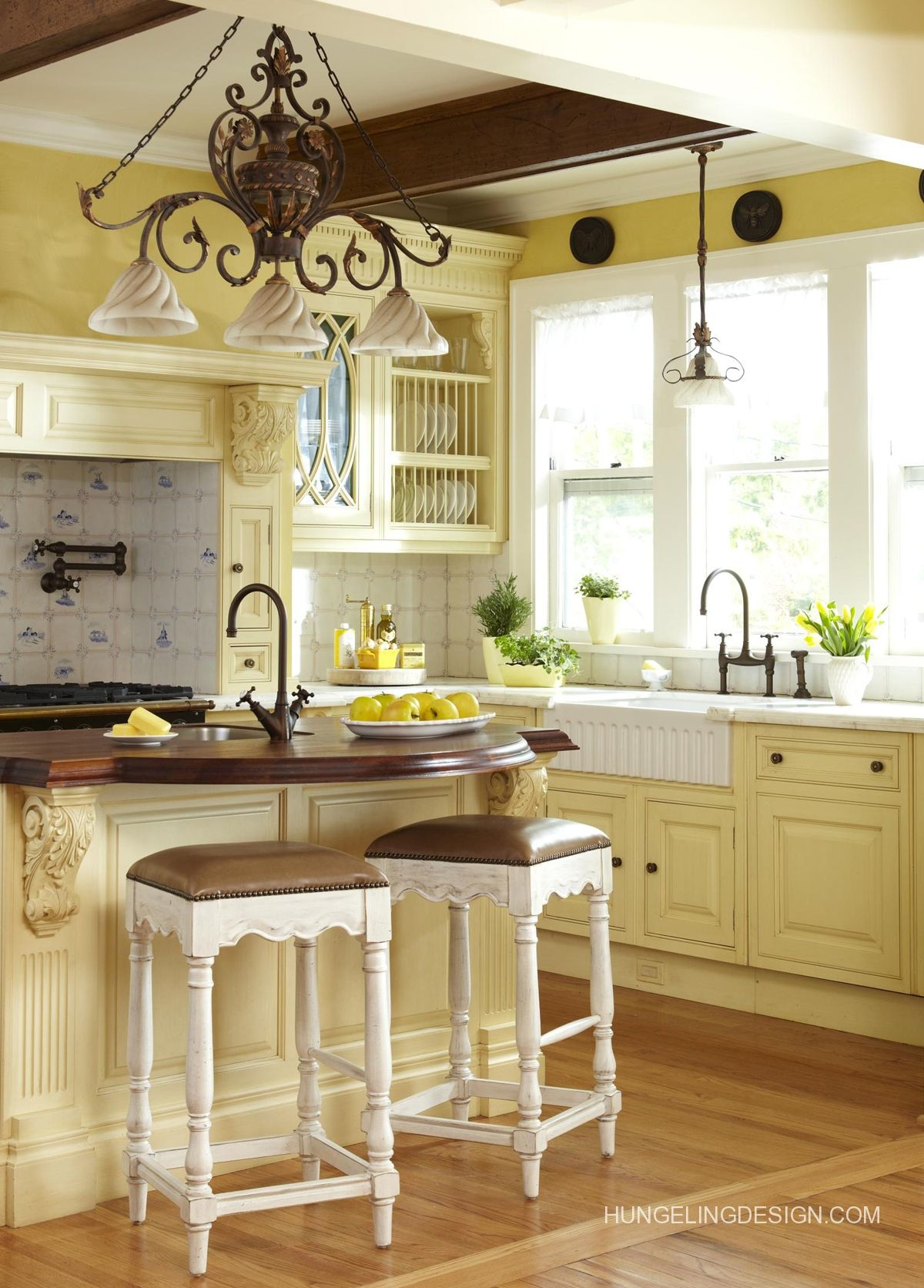 Butter yellow French country kitchen... I found these