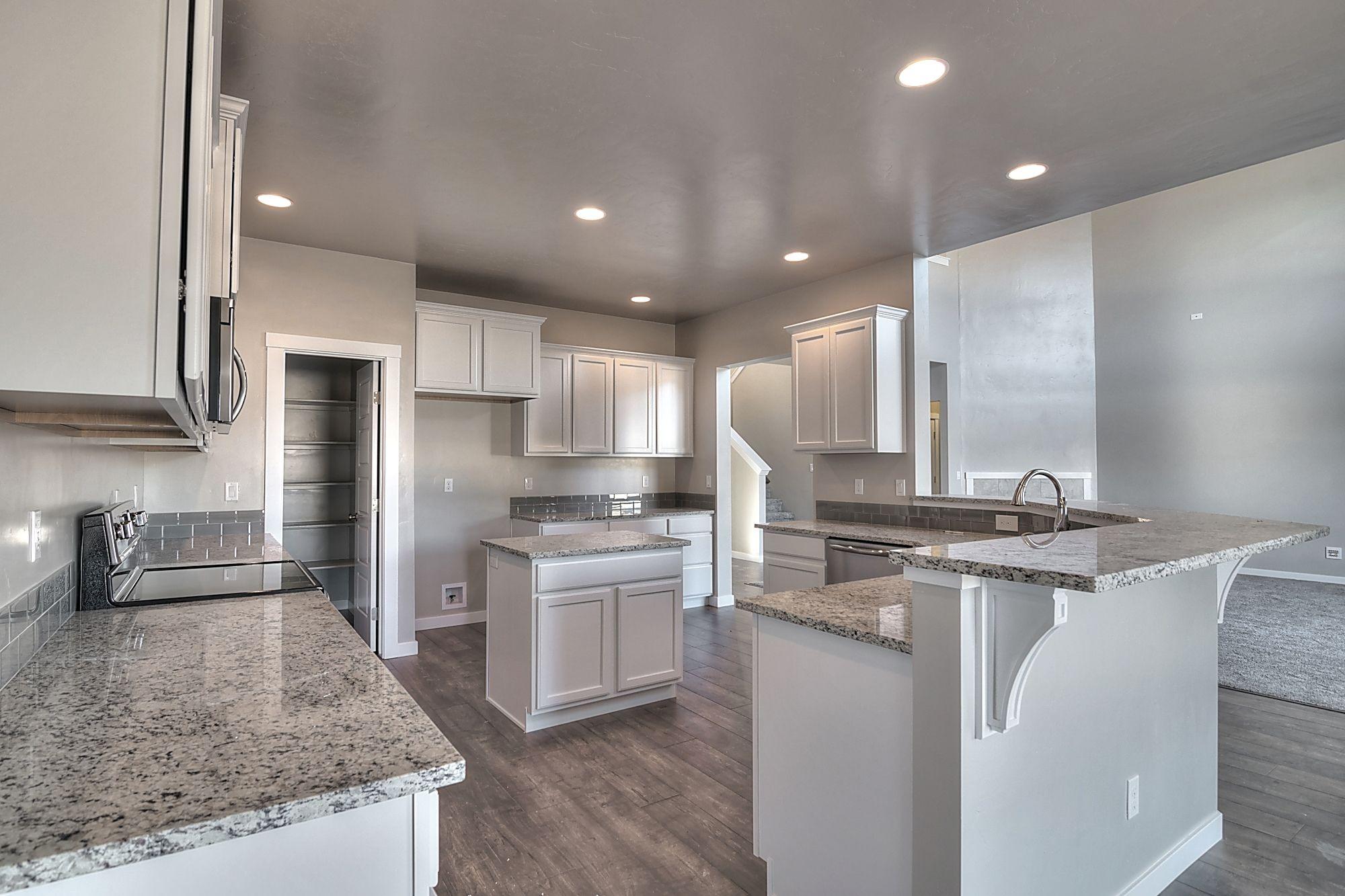 Huge kitchen with Merillat Spring Valley, Maple, Cotton