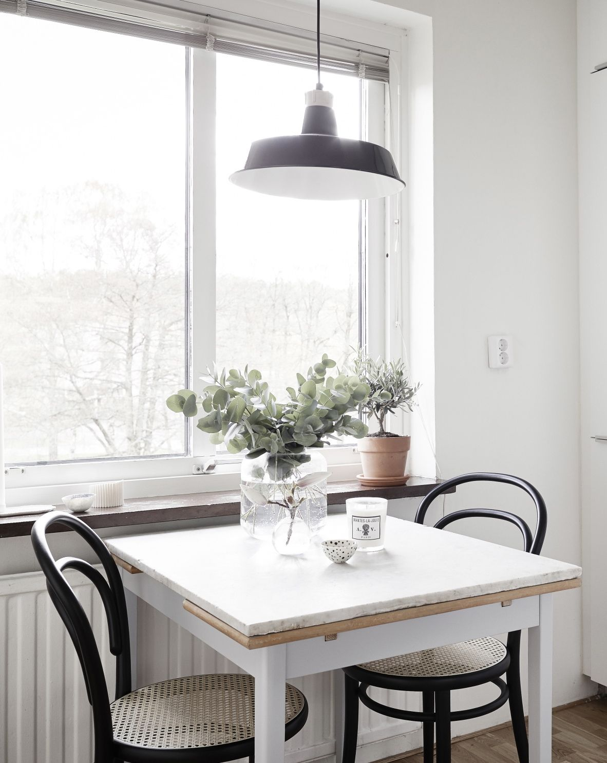 Dining table near the window, chairs k i t c h e
