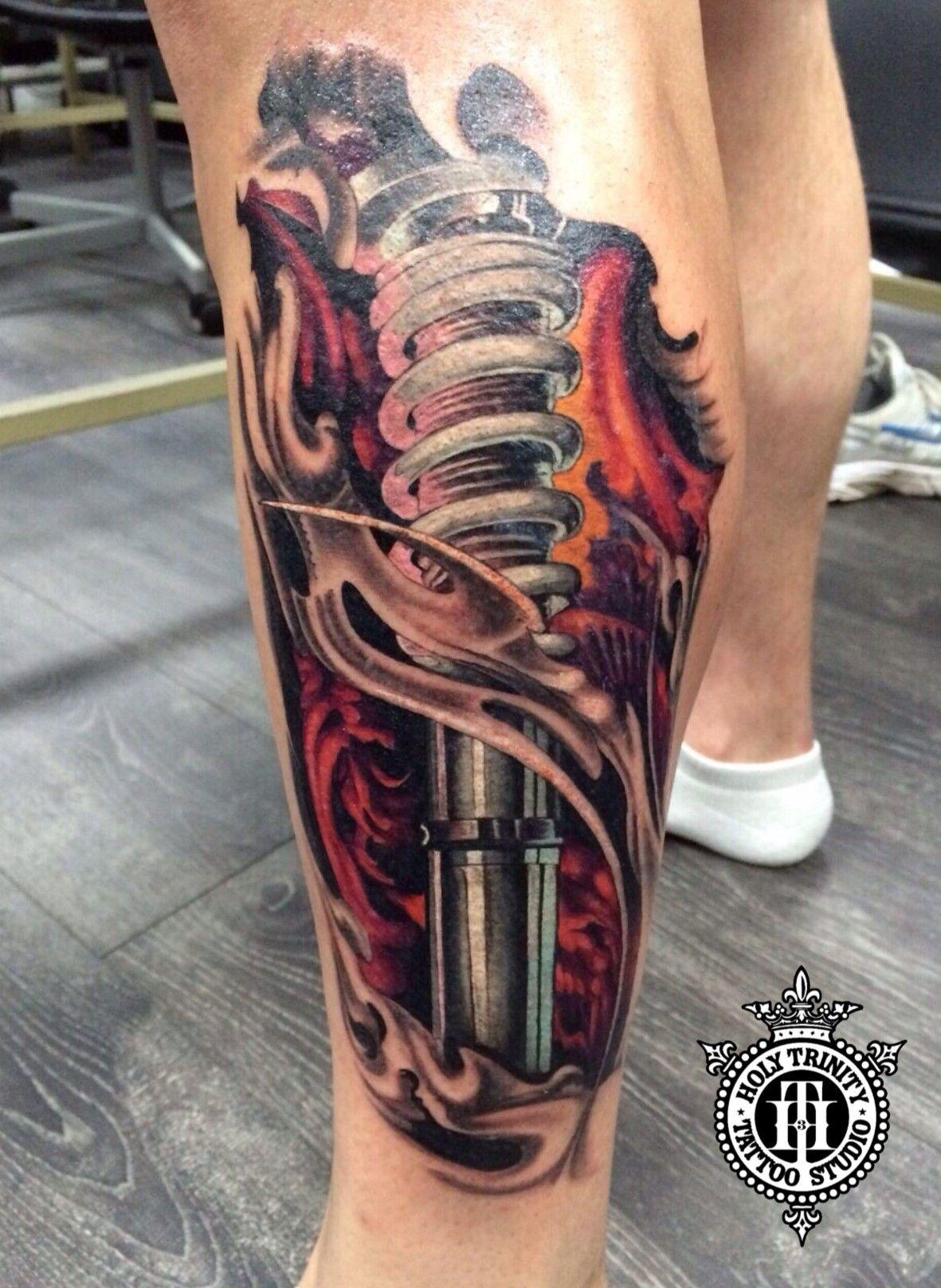 Fantastic biomechanical leg piece tattooed in the studio