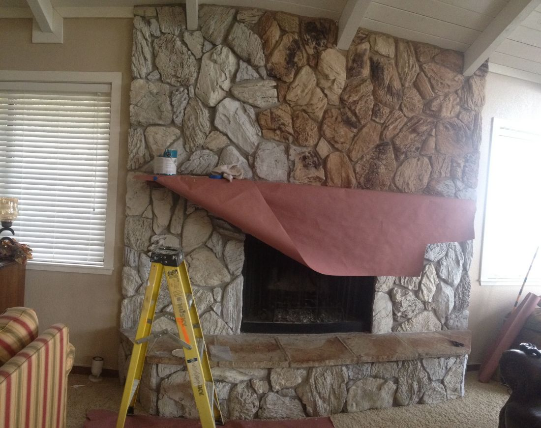 Change your old 70s fireplace with paint keep the rock
