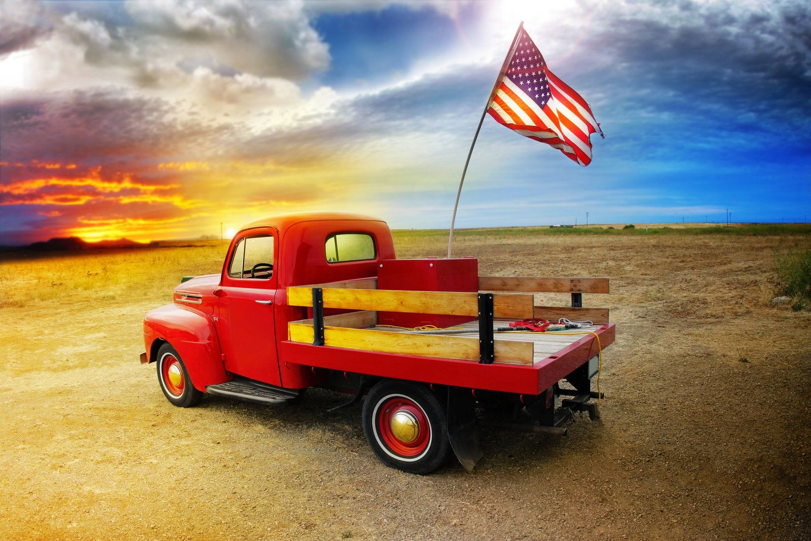 Old Red Pickup Truck With American Flag Facing Northeast