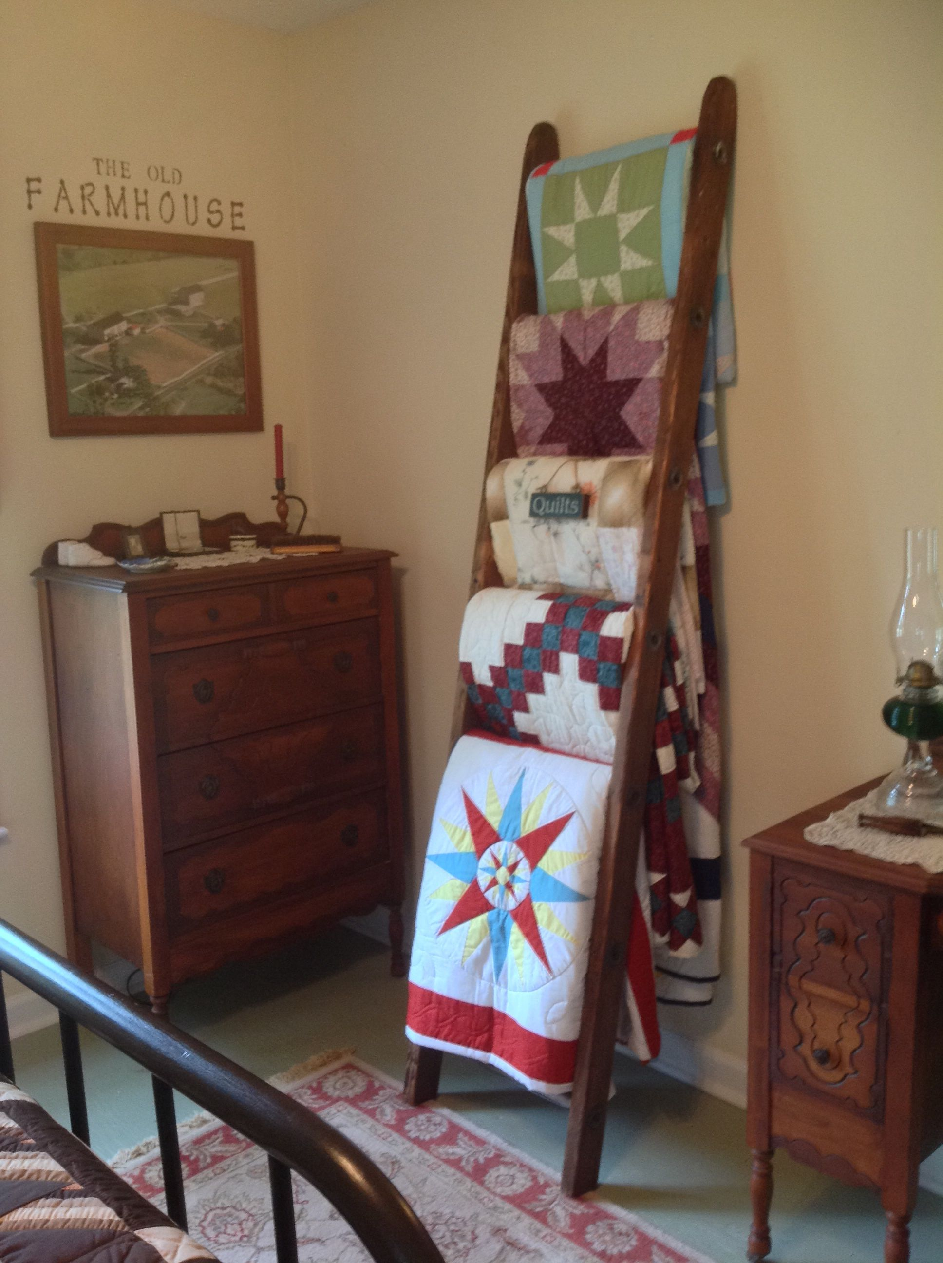 Old ladder turned into a quilt rack. Things I've made or