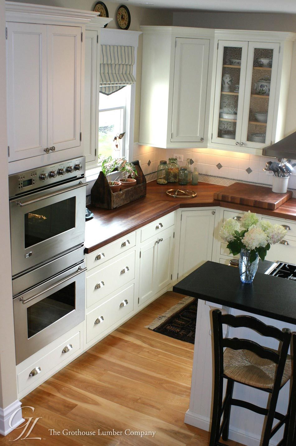 Light floor, white dark wood countertops Custom