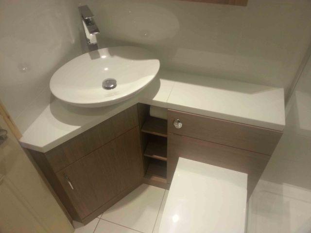 Brown Corner Bathroom Vanity With Spacious Wooden Drawers And