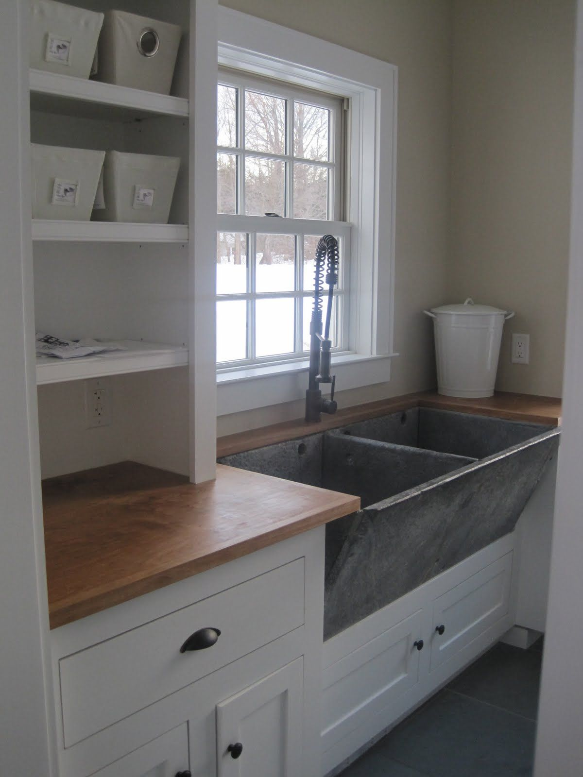 I love the old concrete or stone utility sink. It could be