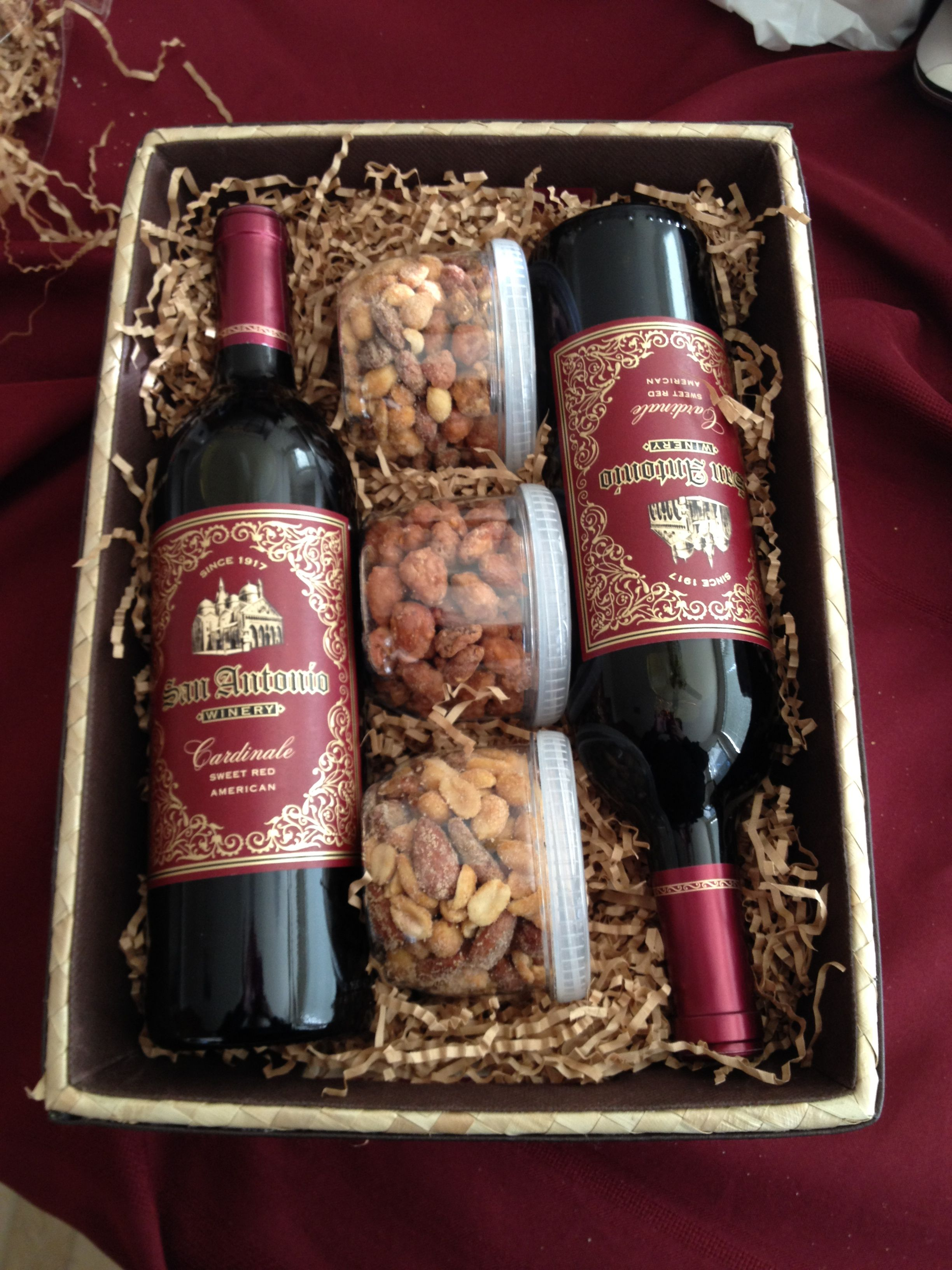 Wine Gift Basket. Nuts are a good idea to add to the wine