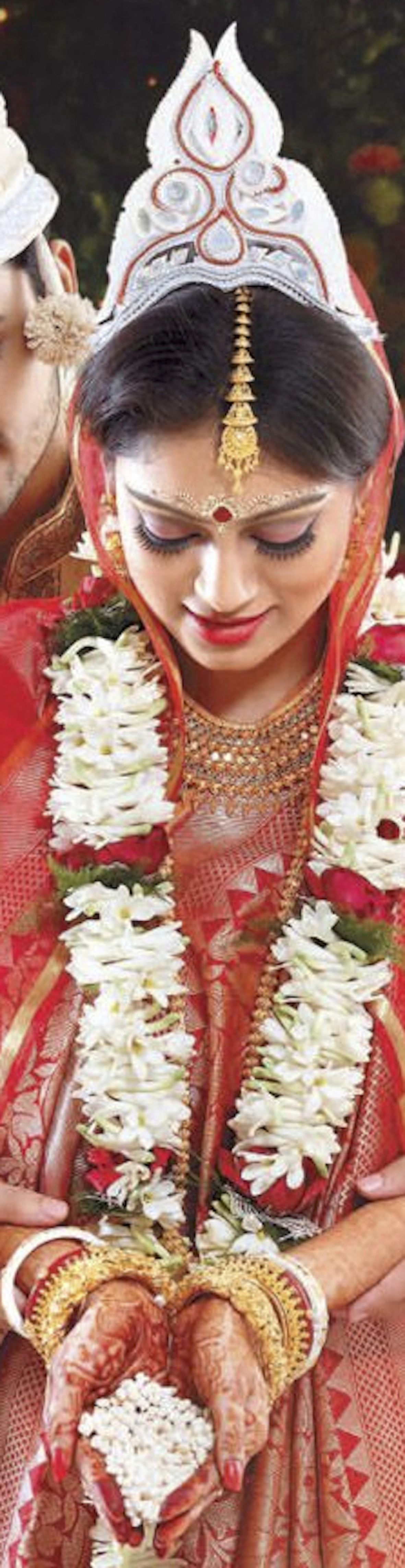Bengali bride with traditional sholapith plant stem/bark