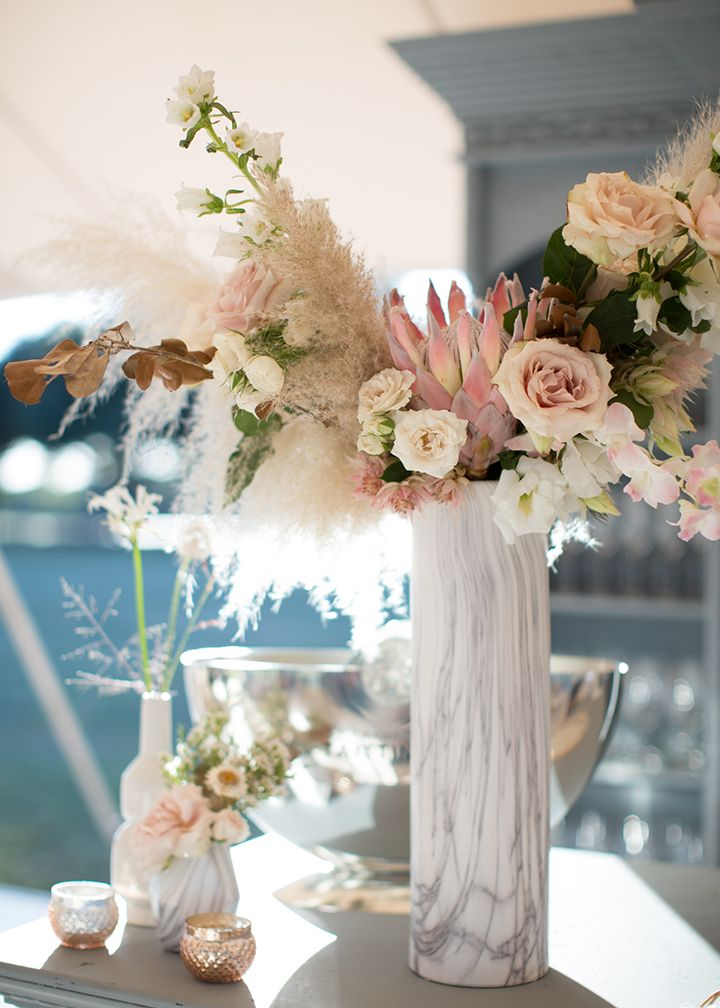 love this tall vase with protea pampas grass roses canterbury bells