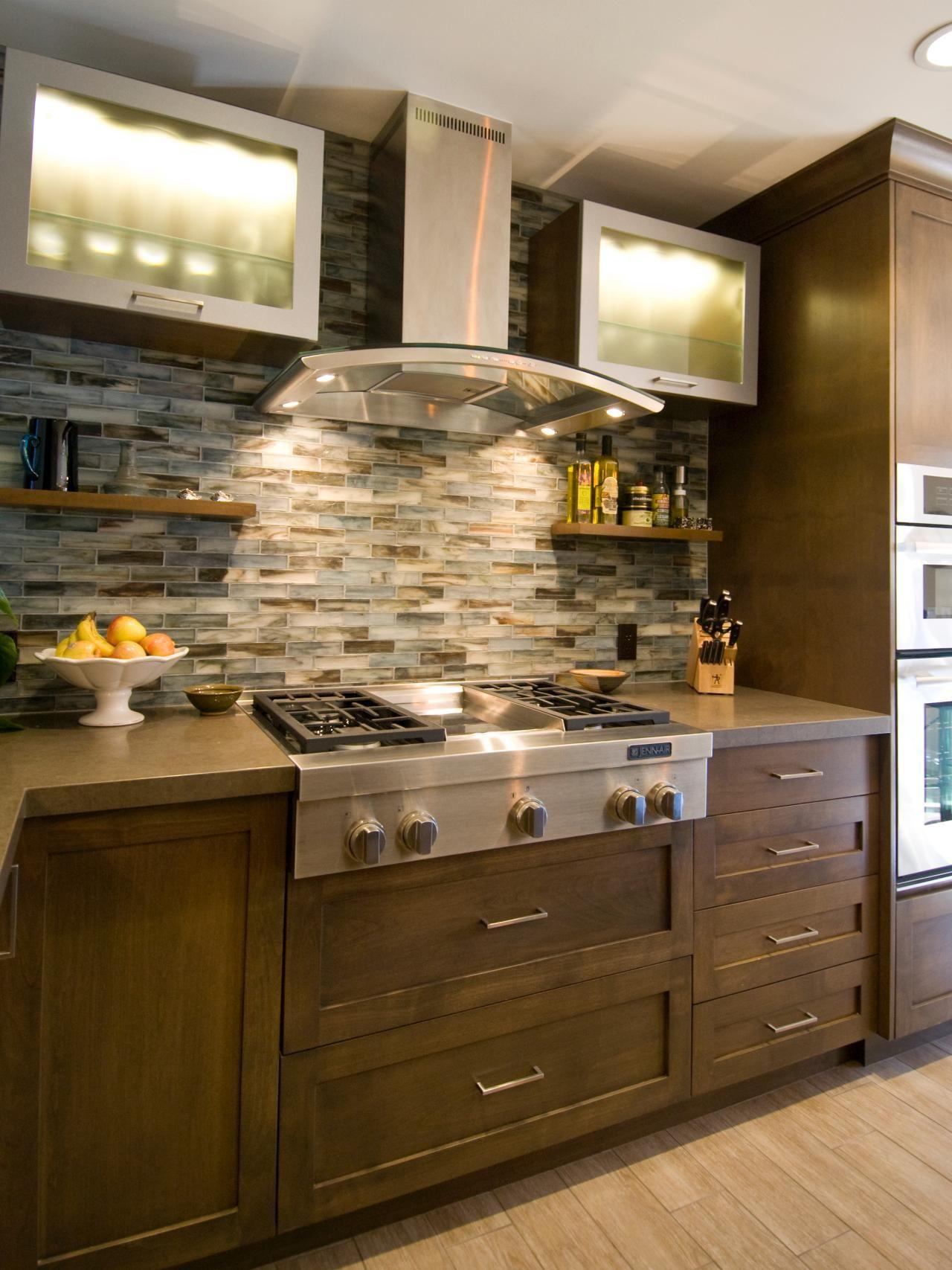 This bold mosaic tile backsplash, open shelving and new
