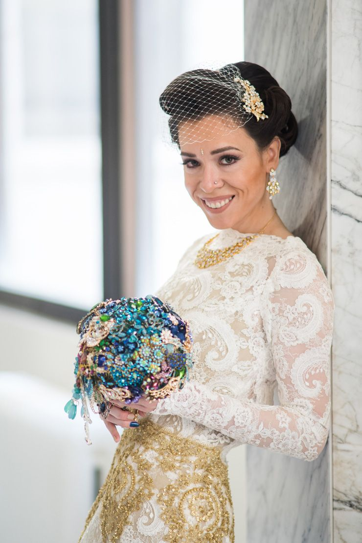 Gold custom made wedding gown and brooch wedding bouquet | sodazzling.com