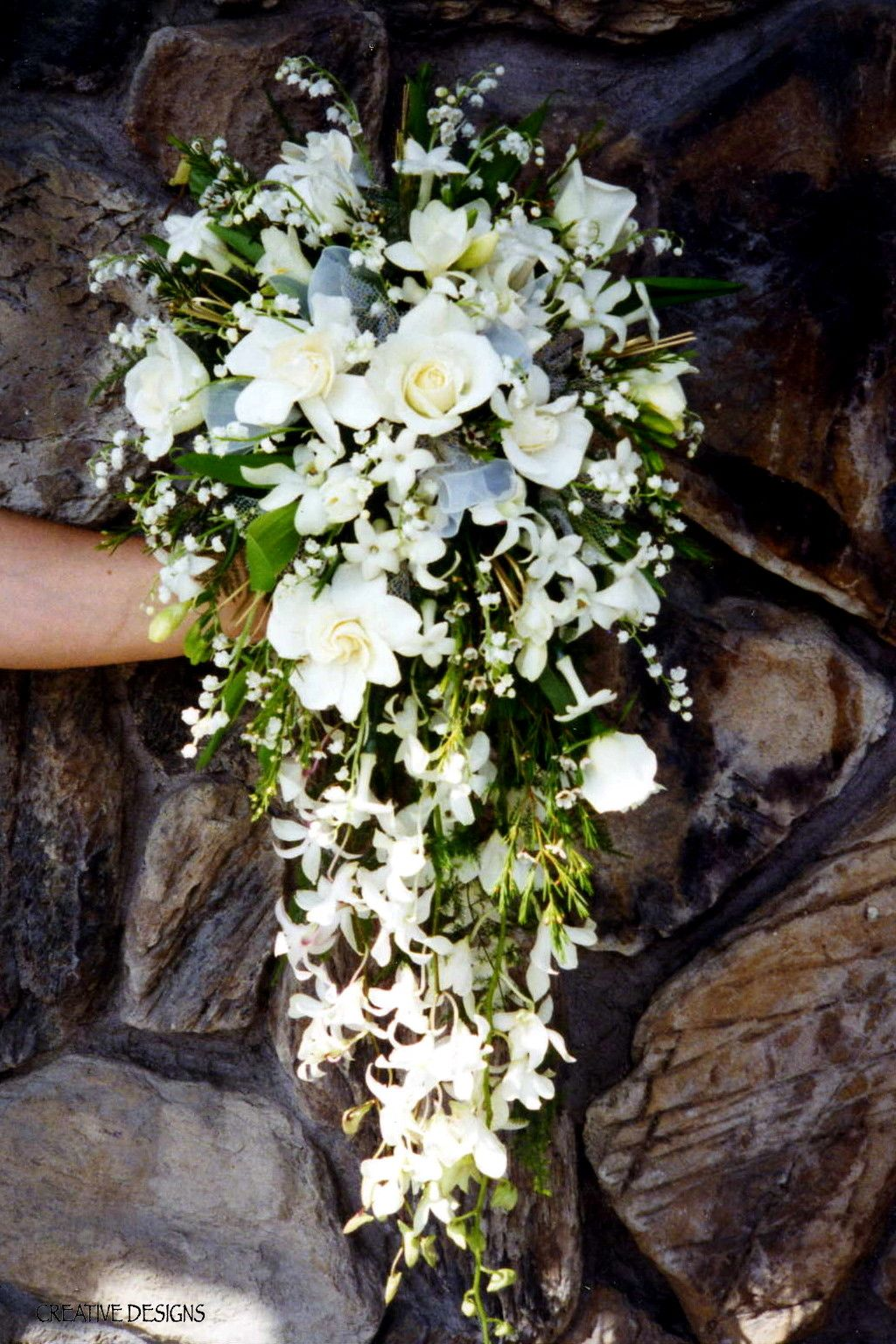 Lily of the Valley dominate this Open End Cascade Bouquet