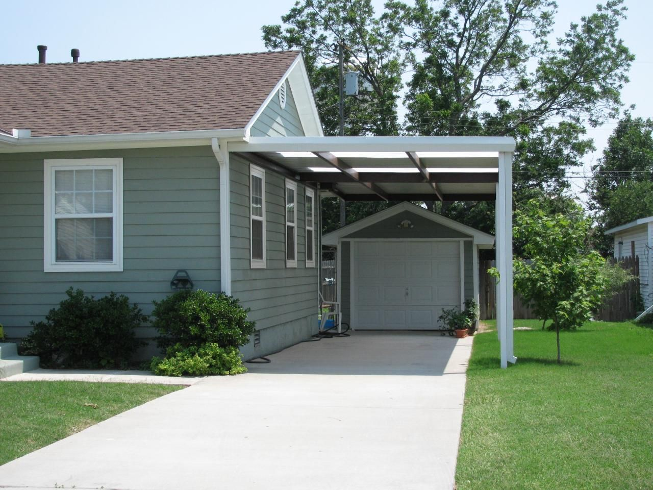 Single carport with skylights Midwest City c a r p o r t